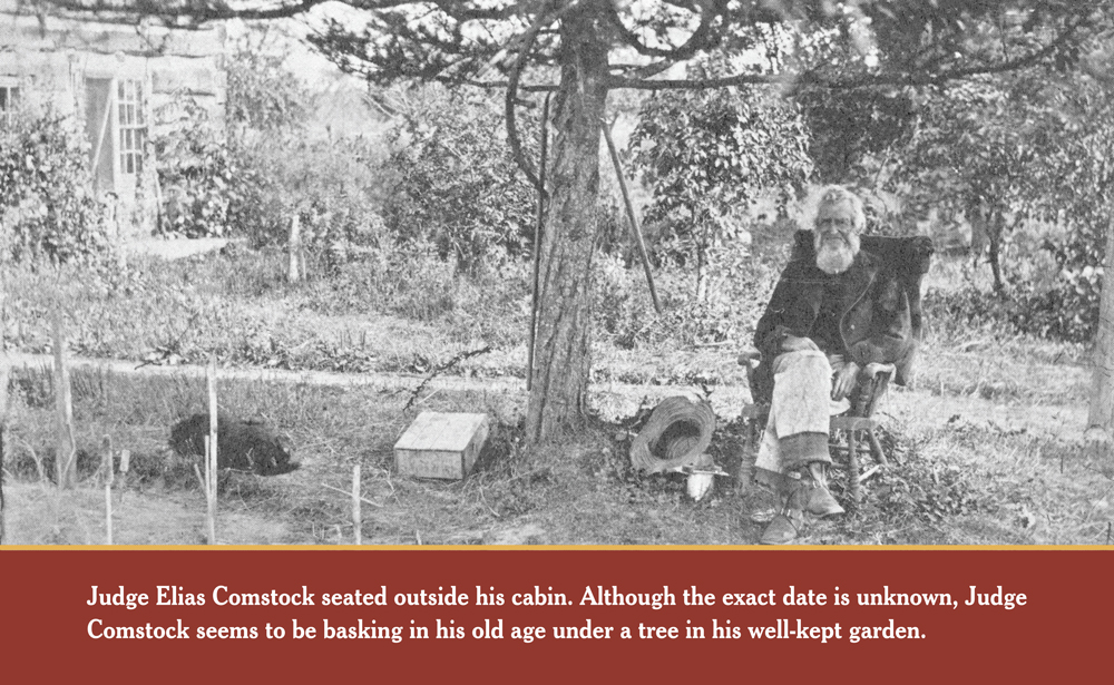 CONTENTMENT: Judge Elias Comstock stead outside his cabin. Although the exact date of this photo is unknown, Judge Comstock seems to be basking in his old age under a tree in his well-kept garden.