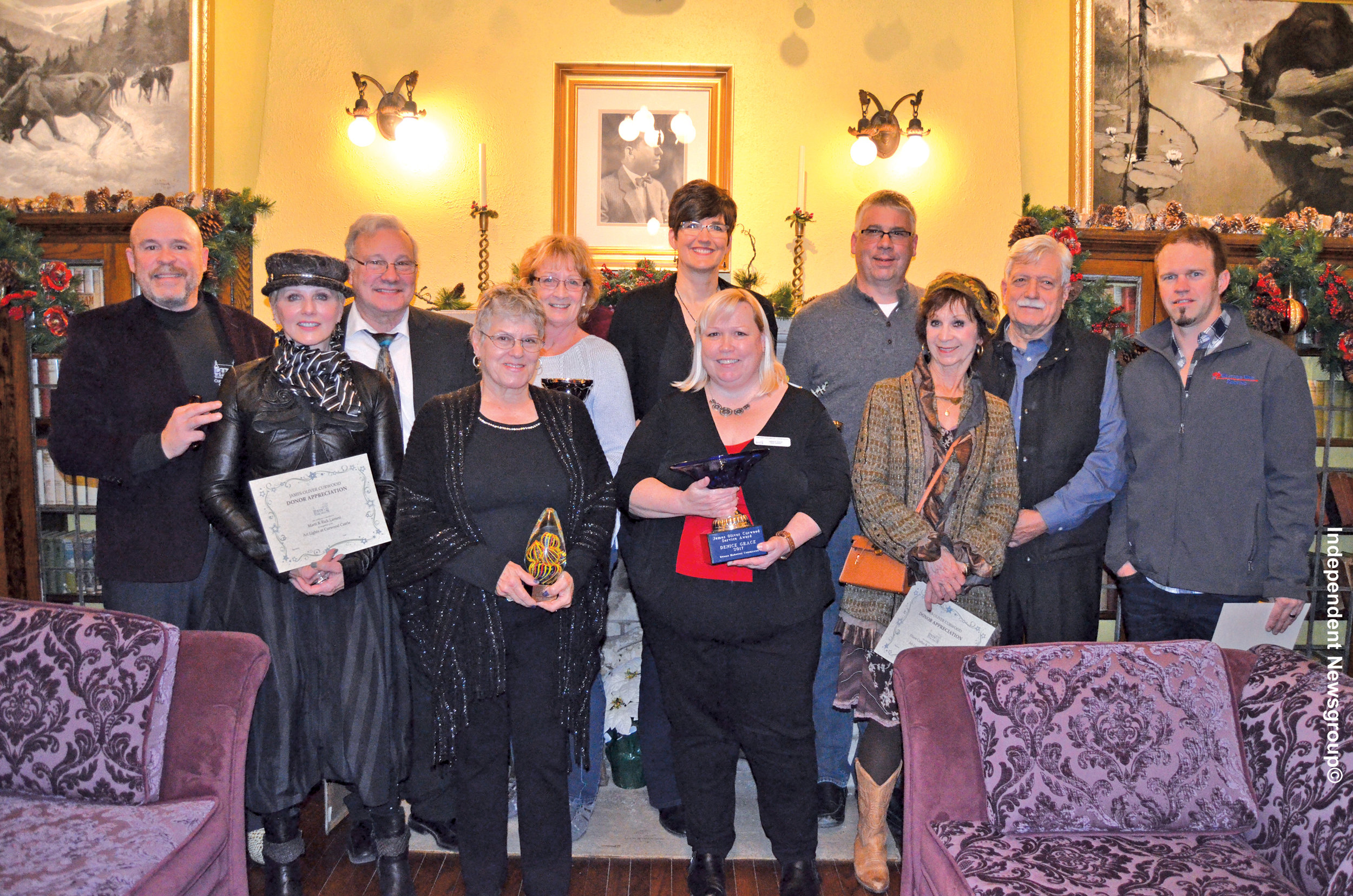 Owosso Historical Commission 2017 Volunteer and Donor Recognition Award Winners, left to right: Robert Doran, Executive Director; Marti Lameti & Rick Lameti, Donor Appreciation Award for Castle Art Lights; Elaine Greenway, Director's Award; Linda Thorsby, Volunteer of the Year Award; Denice Grace, James Oliver Curwood Service Award; Sue Ludington & Carl Ludington, Volunteer of the Year Award; Diane Cutler and Dr. Dan Williams, Donor Appreciation Award for Castle Art Lights; Kris Poag of Weather Vane Roofing, Donor Appreciation Award for new roof on Paymaster Building.