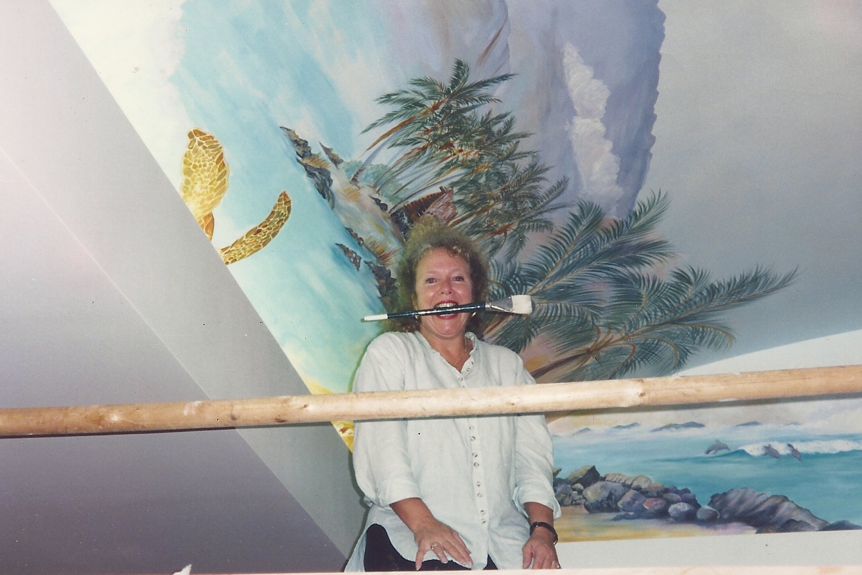 Marcia painting a ceiling mural at Mauna Lani Beach Resort, HI in 1997