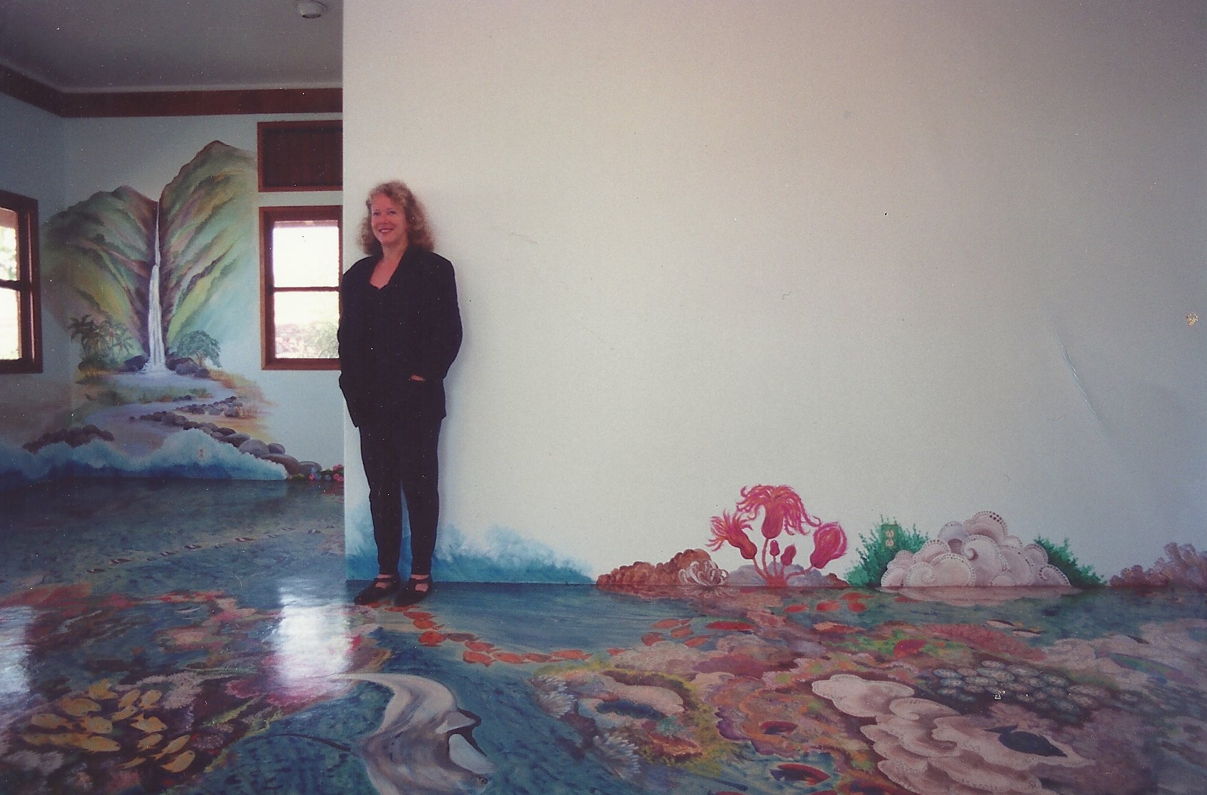 Marcia, painting floor and wall murals at Pua Mau Gardens in 1994