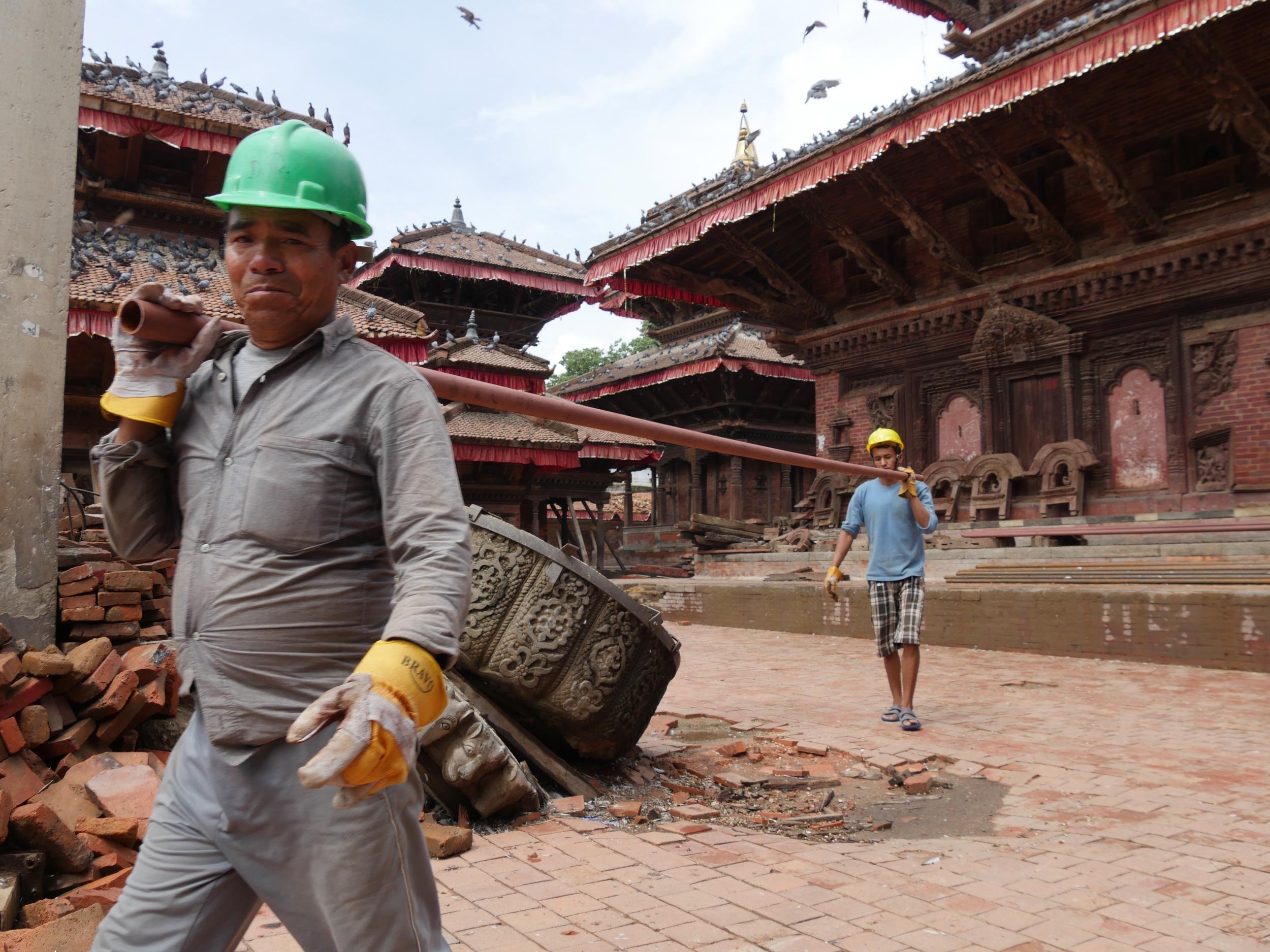Workmen securing structures in Durbar Square