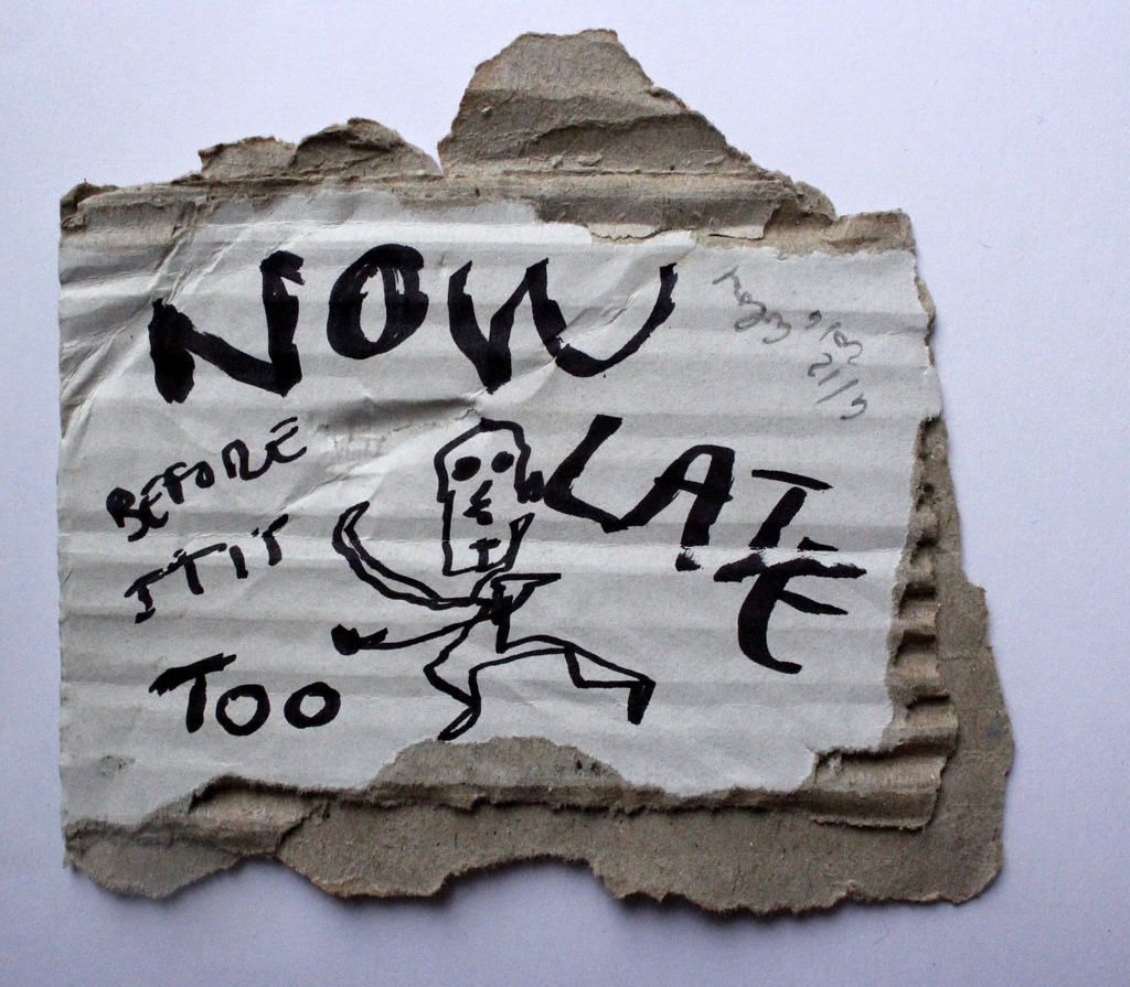 Now before it is too late ,6  /  12   2014 , 7 x 7 c, black marker text and drawing on carton