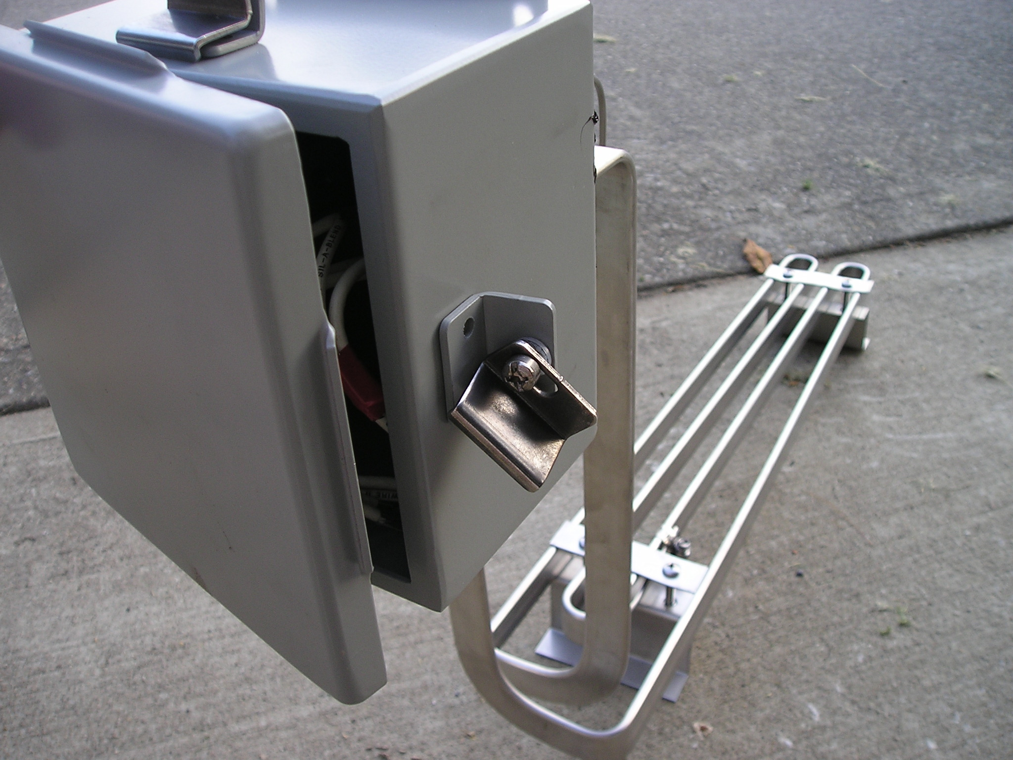 Over-the-side tubular heater with accompanying control box.
