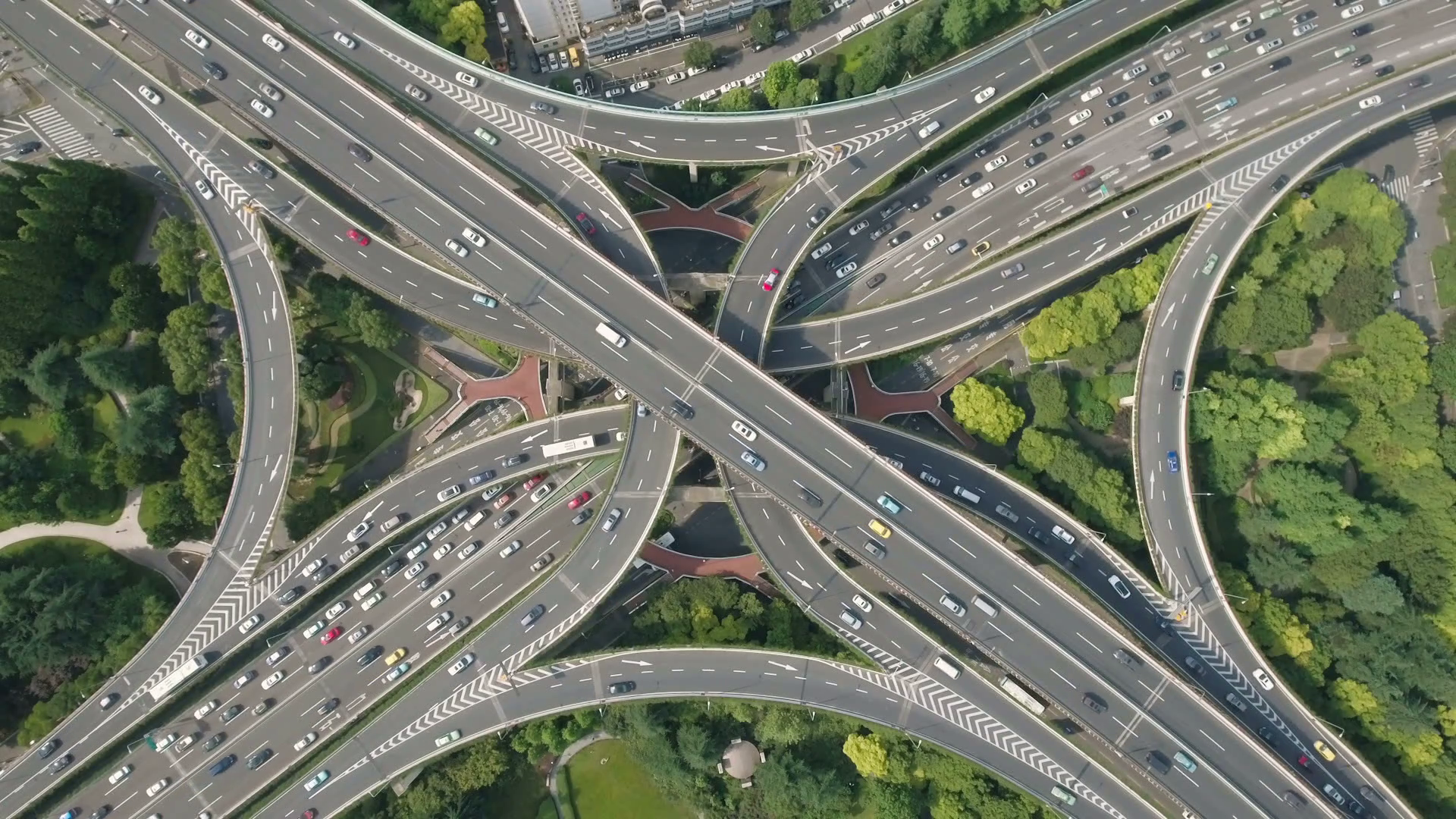 abstract-aerial-drone-shot-of-traffic-driving-over-the-beautiful-yanan-elevated-highway-a-busy-intersection-and-convergence-of-roads-in-shanghai-city-urban-china_stec5e8h6_thumbnail-full01.png
