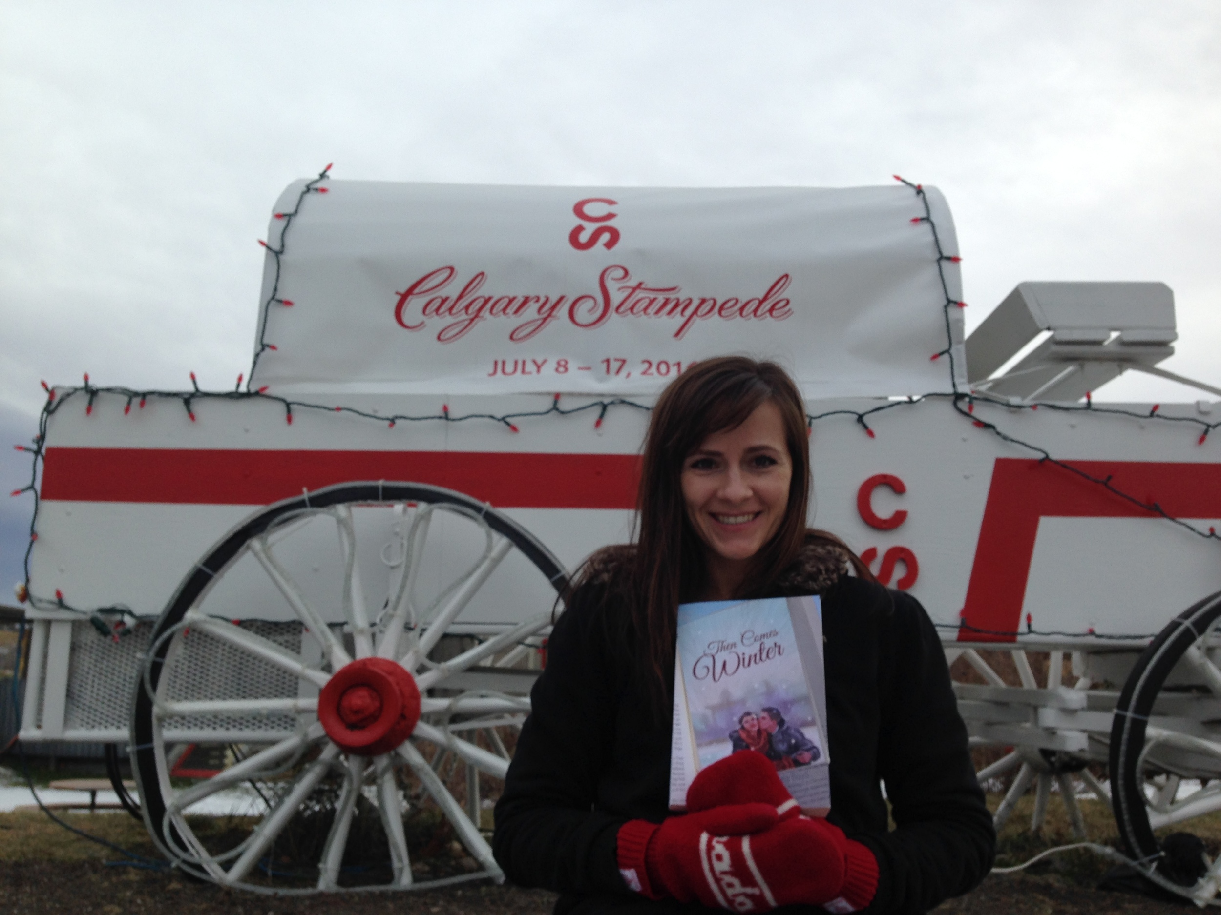 Me, the book, and a chuckwagon advertising next year's Stampede