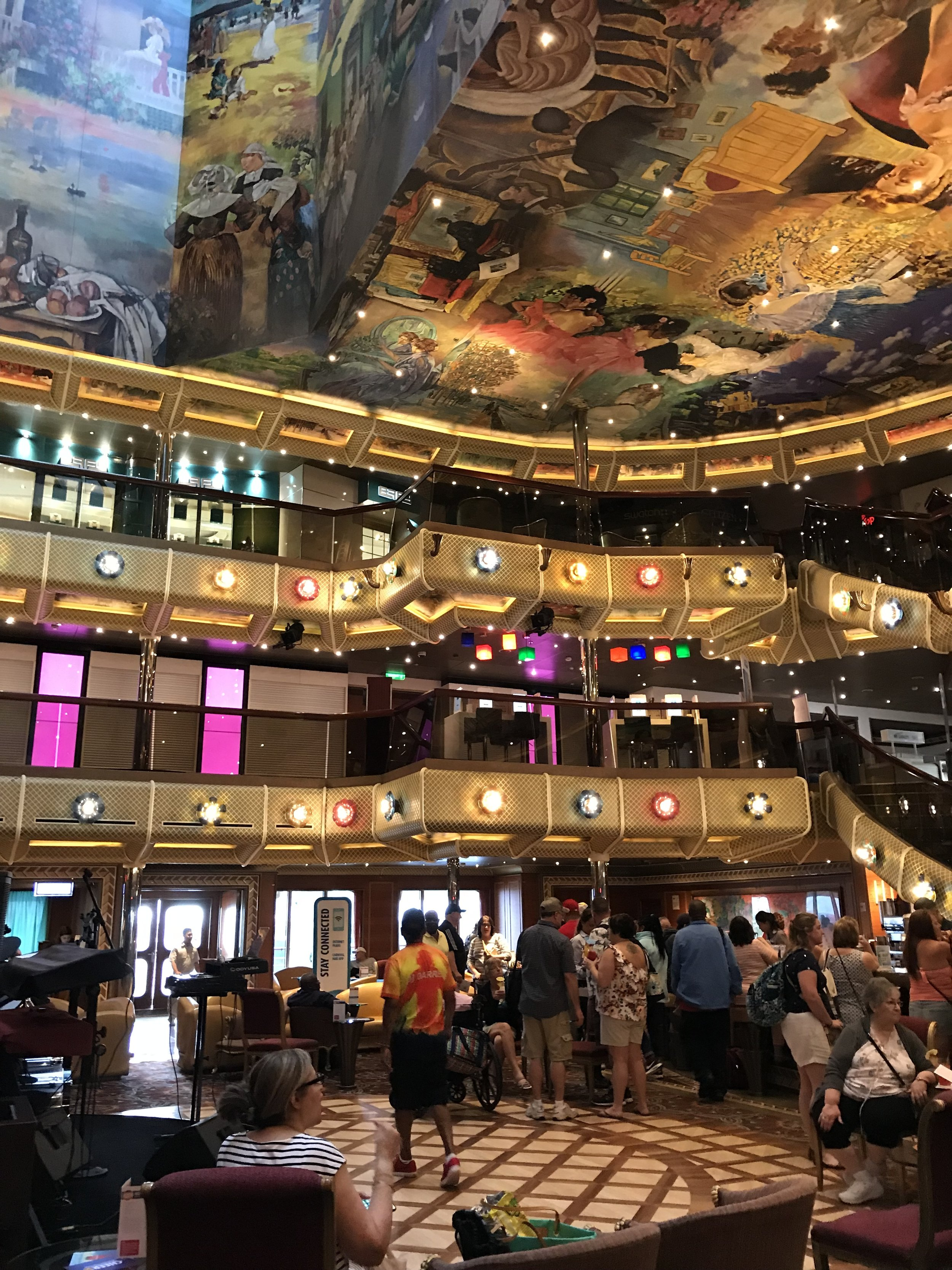 Look how gorgeous this Lobby is! Beautiful art up top and an awesome party below!