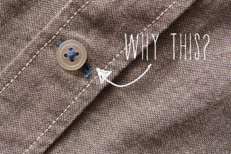 Have you noticed that the bottom buttonhole on your dress shirts are different than the rest of the buttonholes? It's actually a practical design feature.  The hole is sewn horizontally so that the buttons can endure more stress from pulling/movement than the others without stretching out the shirt or the hole itself.  Think about it – the bottom buttonhole is usually going to be tucked in around your waist or over your butt. This area is the epicenter of movement and the shirt will be pulled and moved   all over the place.  If the hole was vertical like the ones on the chest and torso, the stress from the movement would pop it off. Being horizontally placed gives the button more wiggle room. There's also more stitching around the lowest buttonhole. It provides stronger reinforcement so that the button stays in place.  The buttonholes on the torso are vertical so the shirt can have the best fit possible.