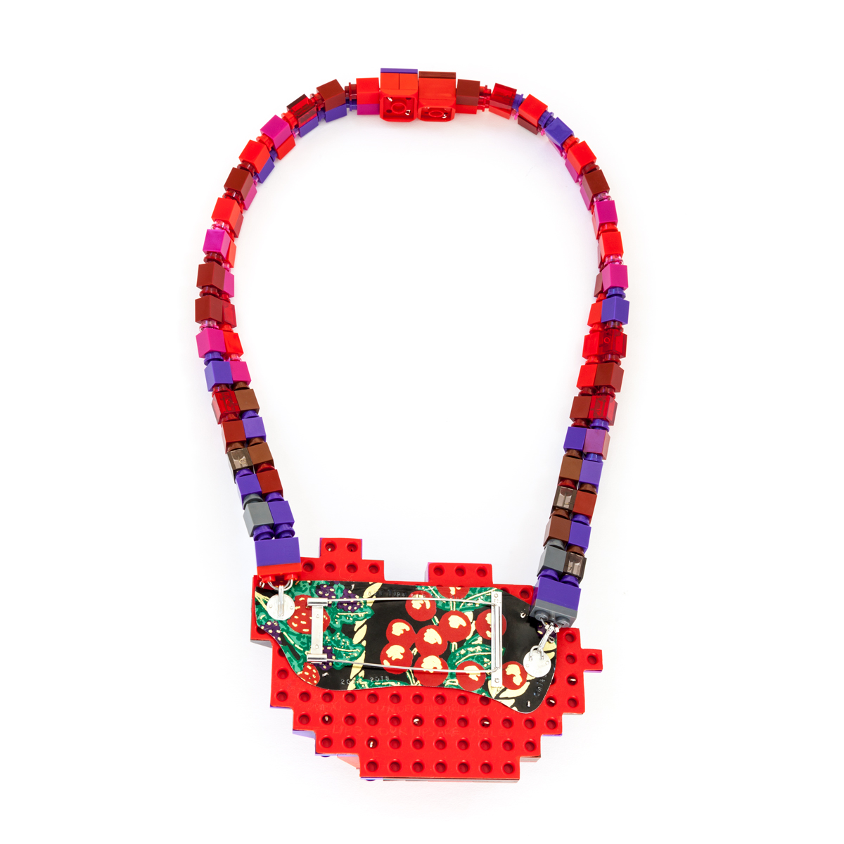 Lip 3: Our Lips Are Sealed (neckpiece back)