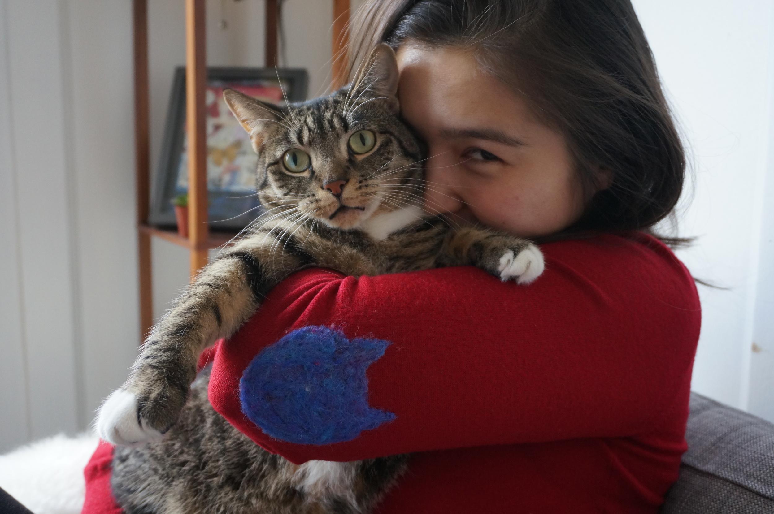 Ta-Da! Unimpressed cat holding is optional