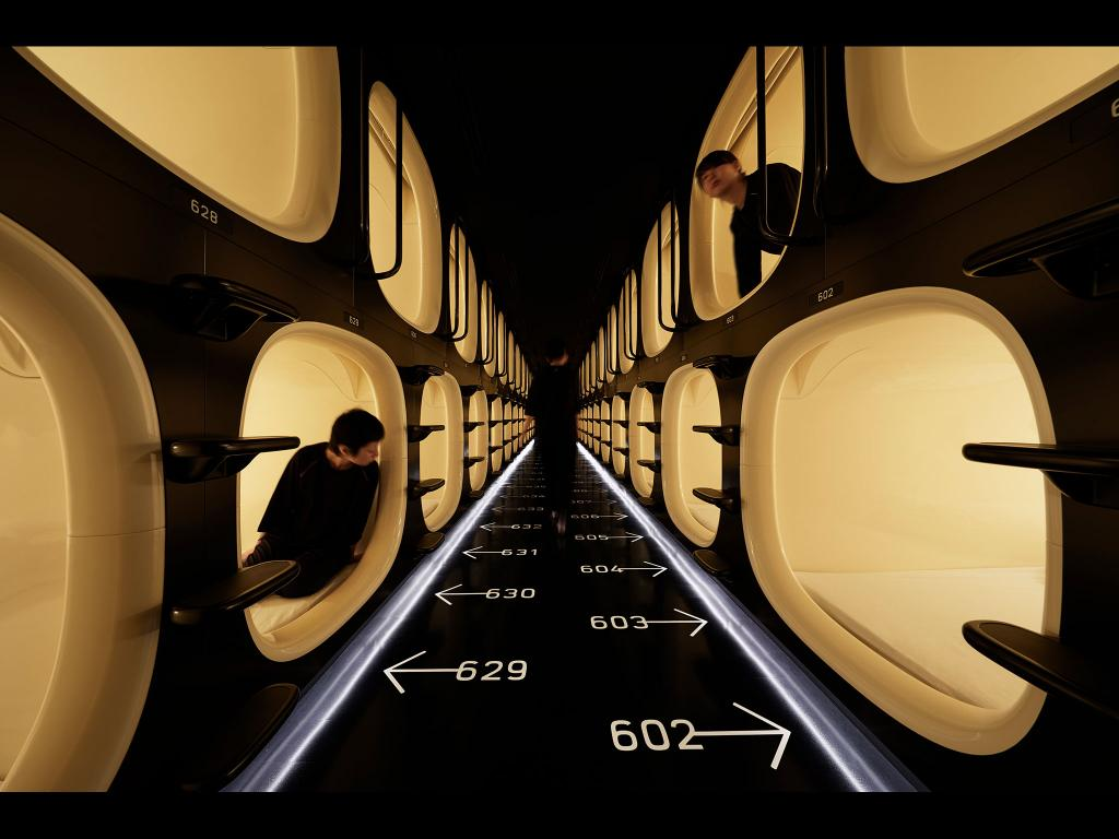 Sleeping pods at Ninehours capsule hotel  (  image source  ).