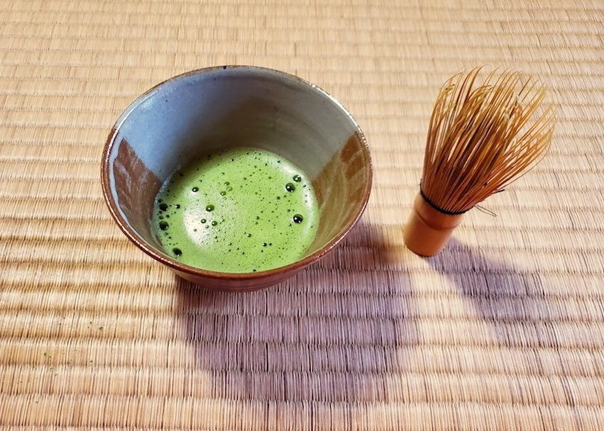 Traditionally prepared matcha tea   at Camellia Garden in Kyoto.
