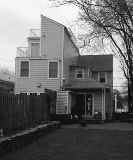 Before - the duplex on the right being dwarfed by it's neighbor.