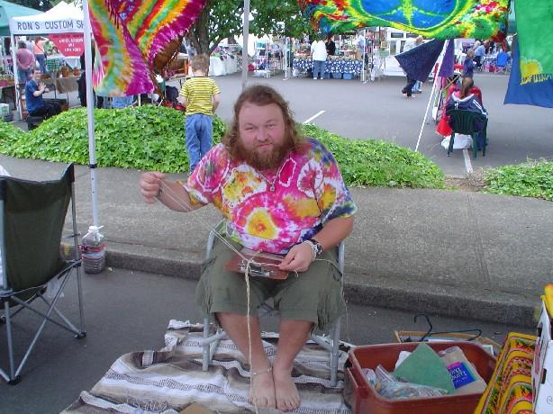 Erik tying up a hemp bracelet at the Gresham Farmers Market in 2006.