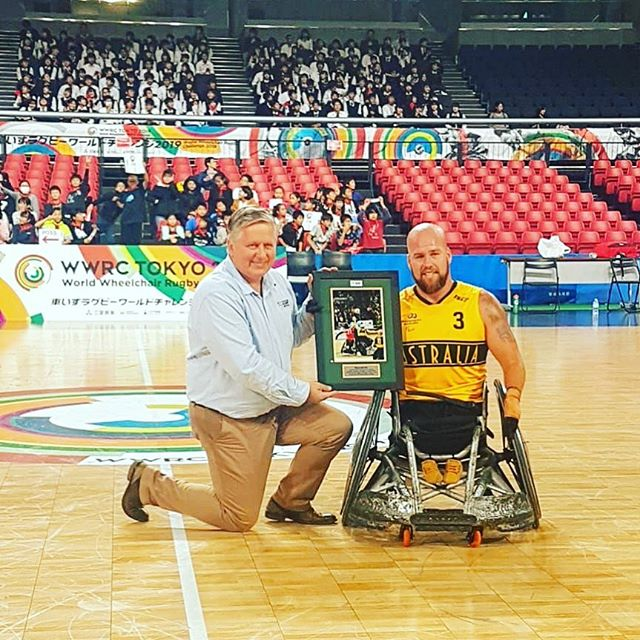 Congratulations to @ryleybatt on reaching the 300 game milestone for the Australian Steelers against Canada yesterday in Tokyo. A phenomenal individual achievement!  Pictured here is Ryley with @wheelchairrugbyau advisory board member Steve Loader receiving a gift post his 300th match.  The Steelers play again this evening vs USA at 6:15pm. You can stream the match live here 👇👇 https://www.youtube.com/channel/UC9KsTs2WaA52ExVLYW4uglA/featured  #wheelchairrugby #wwrc2019