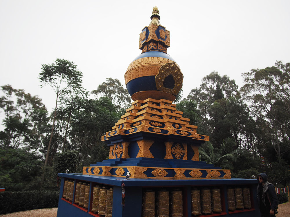 Kalachakra Stupa with brass mani wheels at its base - each containing 130,000 prayers beat into the metal by Nepalese craftsmen.