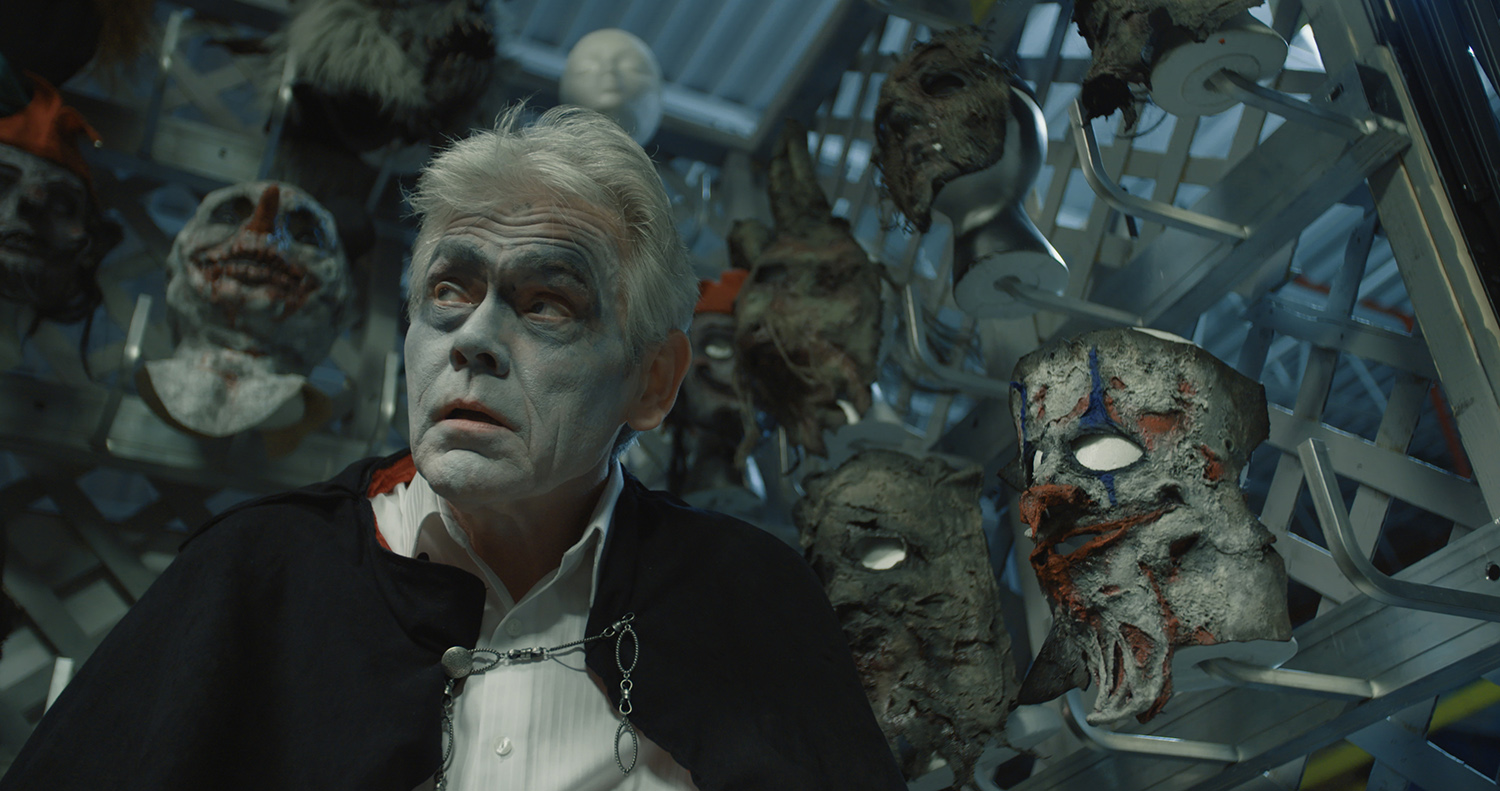 Often,we can't tell if John is wearing the costume, or if in fact the costume is wearing  him . Behind are masks, which can be seen literally as they are, or as the many burdens that the Creep has to  face,  or possibly his demons.