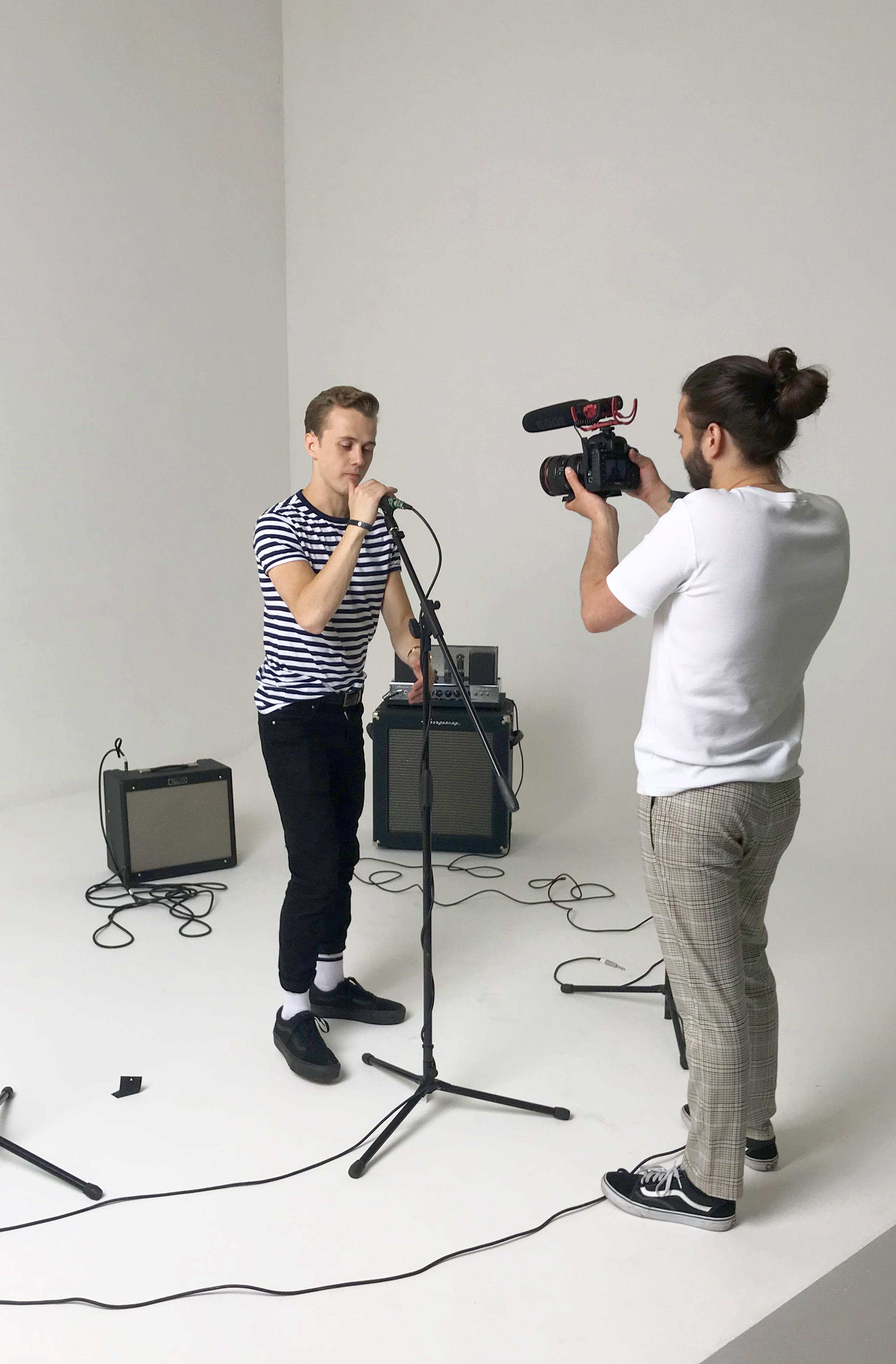 Nathan with the band's videographer, taking charge of the behind the scenes content.