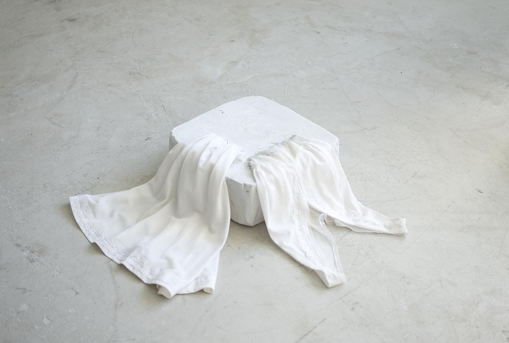 Float/soft skin  (2015), 57 x 54 x 14cm, plaster, inherited undergarment