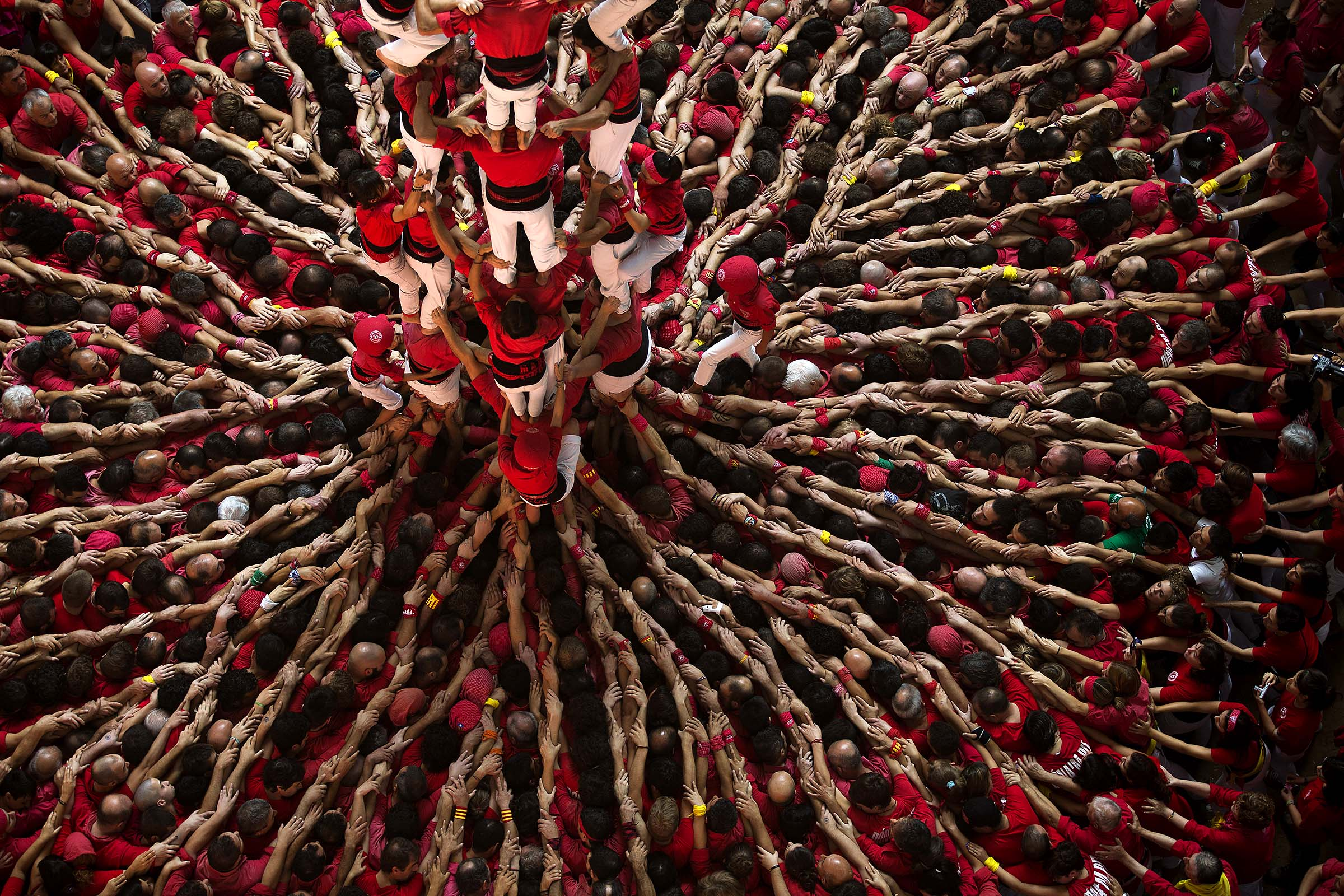 Members of the Castellers Joves Xiquets de Valls try to complete their human tower during the 25th Human Tower Competition in Tarragona, Spain. (Emilio Morenatti/Associated Press)