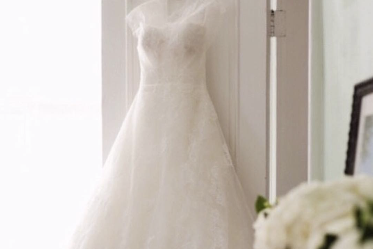 the Aisle Experience - Gown delivery the day of your wedding within the Triangle region. Priced at $500 and also includes:• Pressing of gown and veil at your ceremony location• Assistance dressing and styling bride• Bustling of gown after ceremony