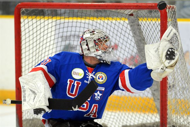 Ben normally plays for the Italian National Paralympic Sled Hockey team, but here he is filling in for the US team's goalie after an injury.