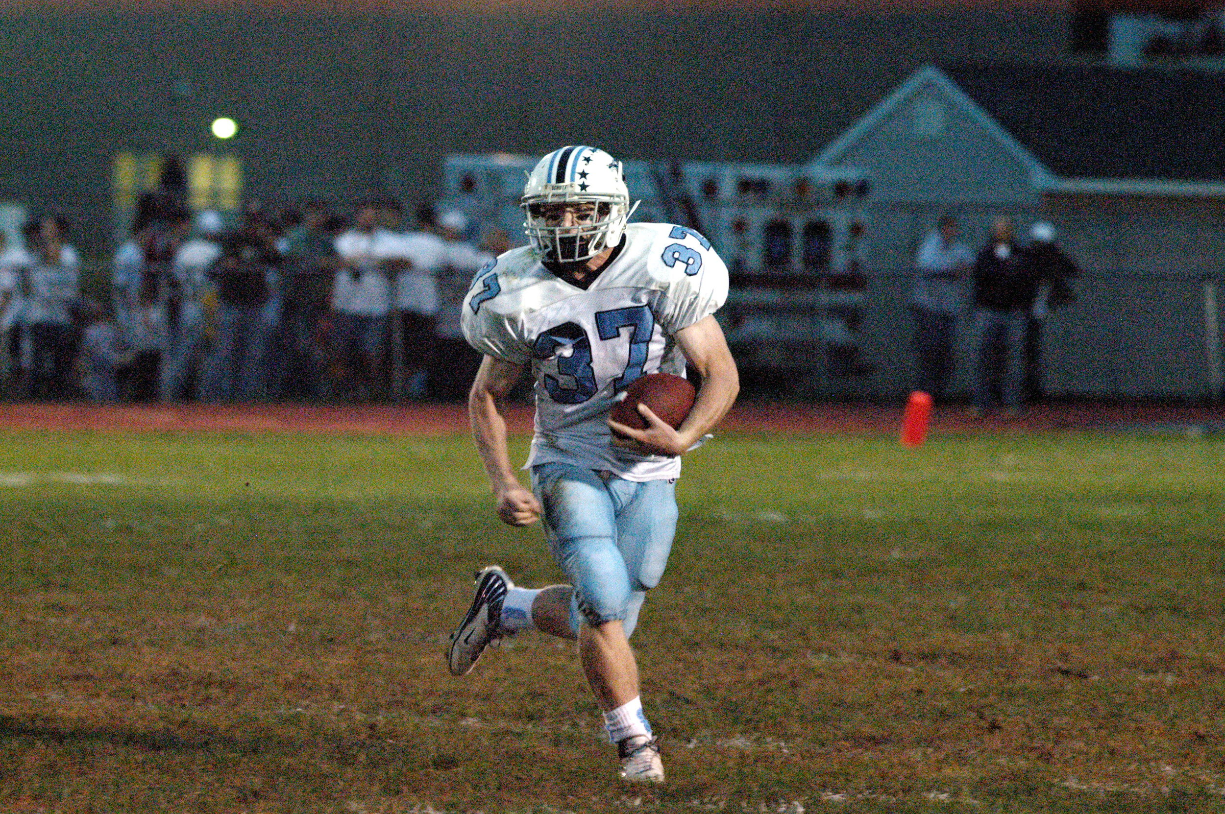 Although this may just look like a normal picture of me running the football on a Friday night in 2007, there is actually a lot more going on. Take a look at my right hand. My clenched fist is in preparation for attempting to run over the Roxbury High School outside linebacker. I succeeded, but at a cost. I separated my shoulder on this play, which led to hurting my opposite shoulder and then using my head as a weapon. I truely believe if I sat out for this shoulder injury, I never would have injured my brain to the extent I did.