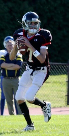 """Pictured, Gunnar Slangin' it in HS. I asked Gunnar if he ever felt extra pressure playing football because of the success his father had on the field, but Gunnar says his dad had a good parent-coach relationship when it came to football and was more of a """"hockey Dad."""""""