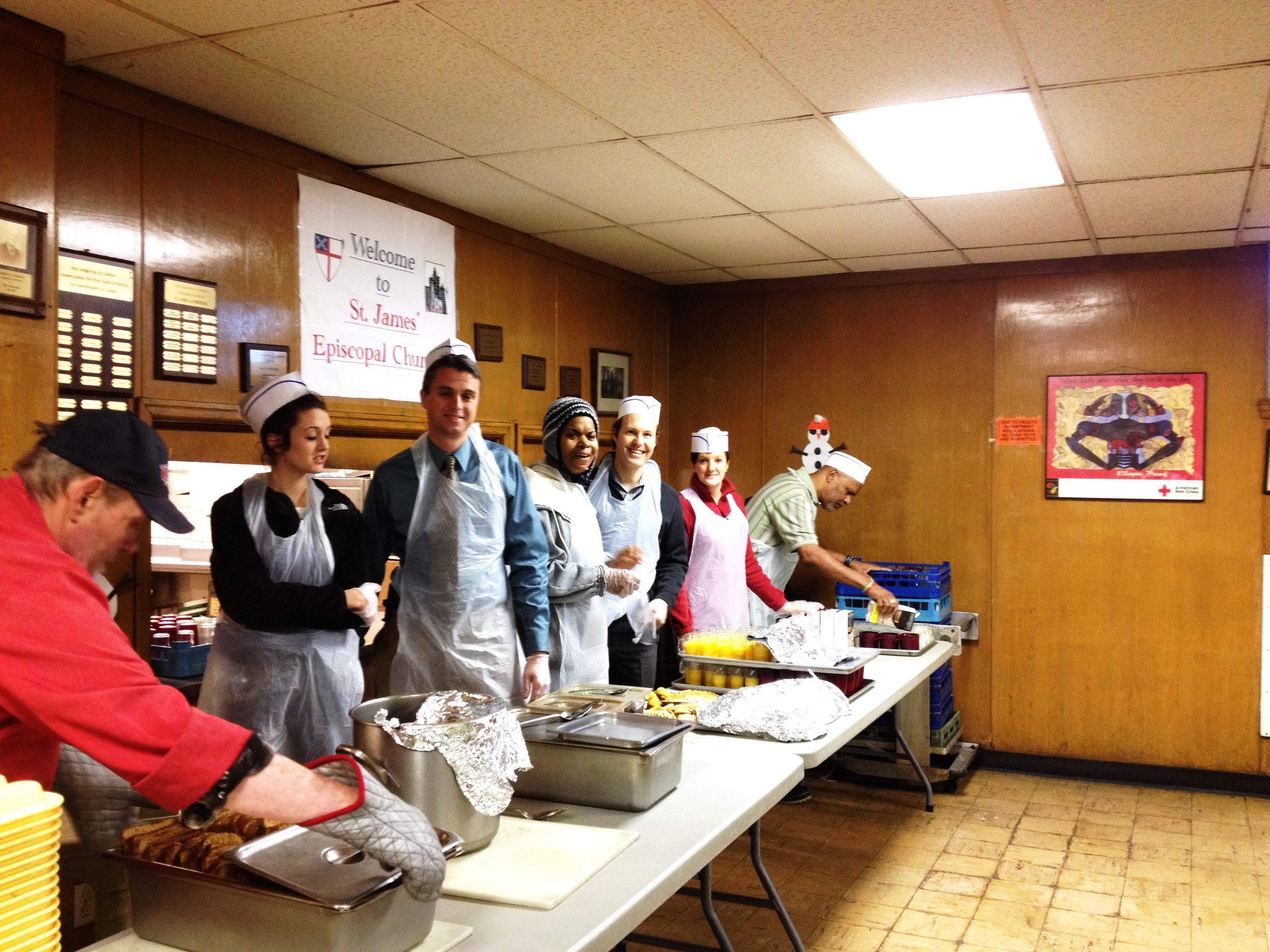 Stephanie (center) and fellow volunteers in the serving line