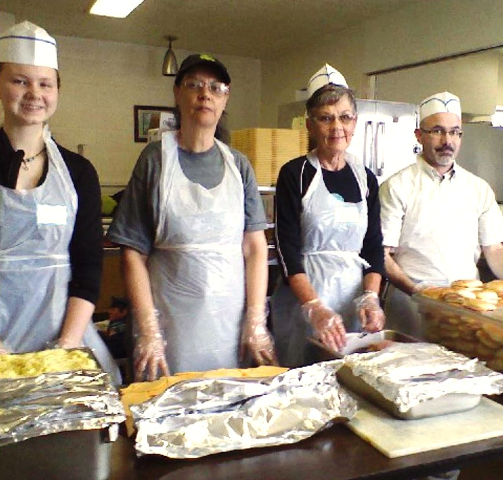 Jeanne (second from the right) with fellow volunteers at the dinner program