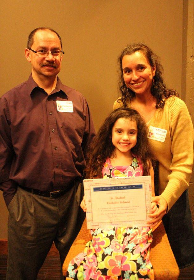 Dan, Natalia and Miriam accept the award for St. Rafael Catholic School