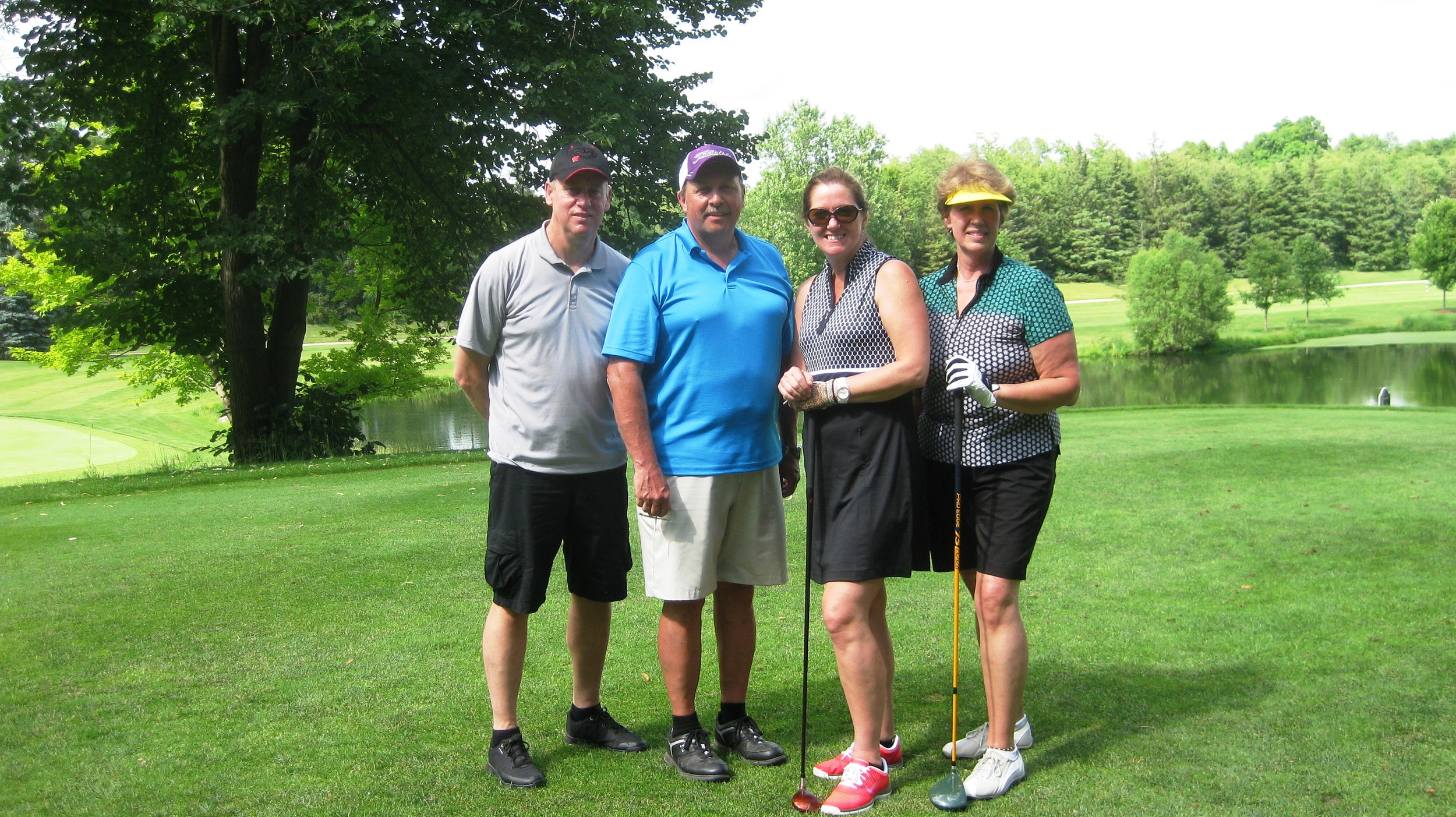 Ray, Jim, Lisa and Deb - go for the hole-in-one
