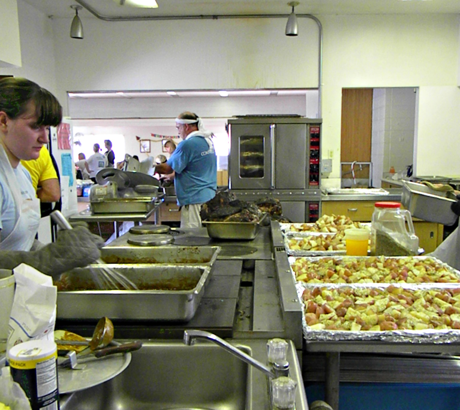Cooks prepare over 150 lbs. of potatoes