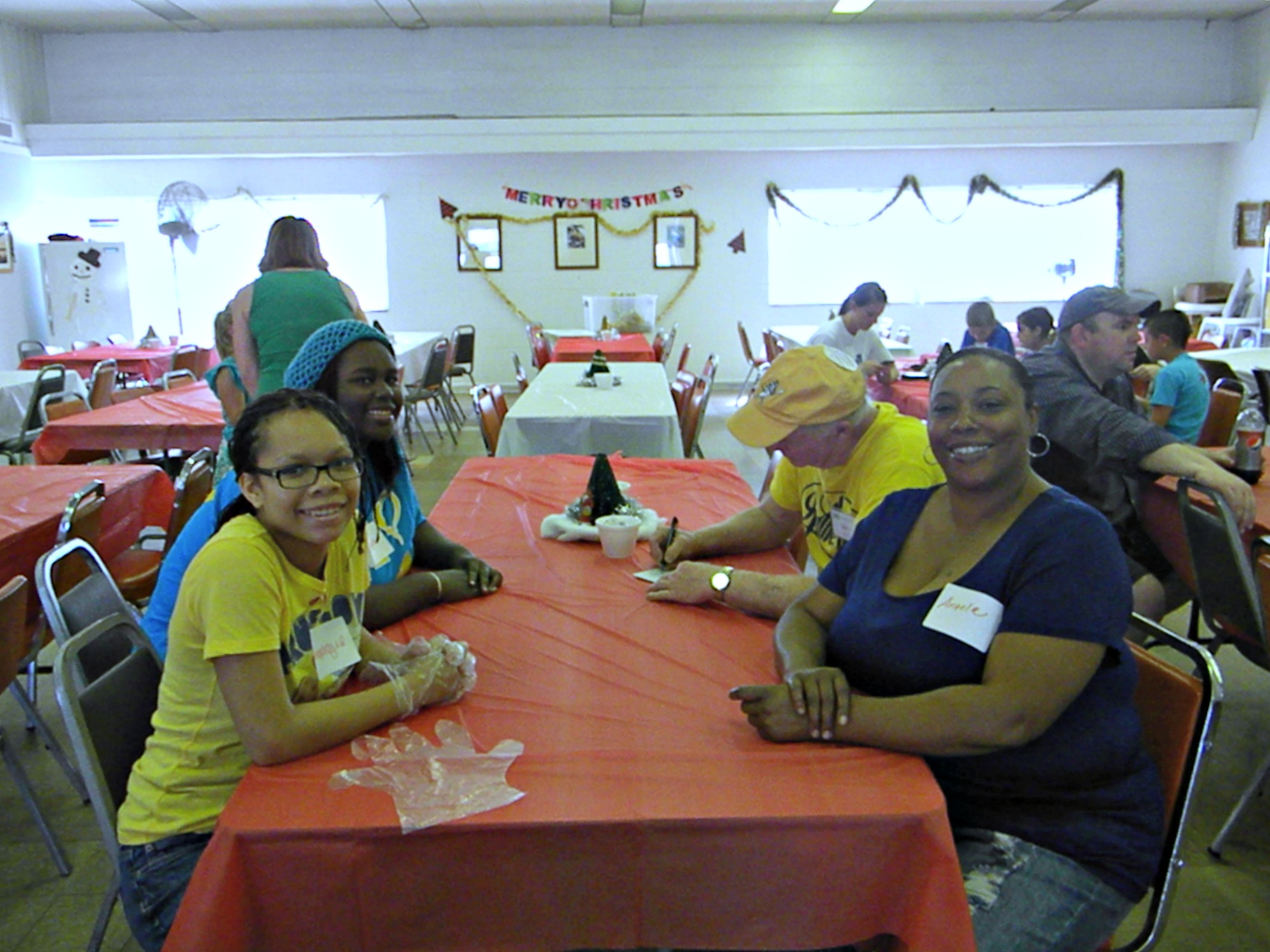 Volunteers decorate and plan before the meal
