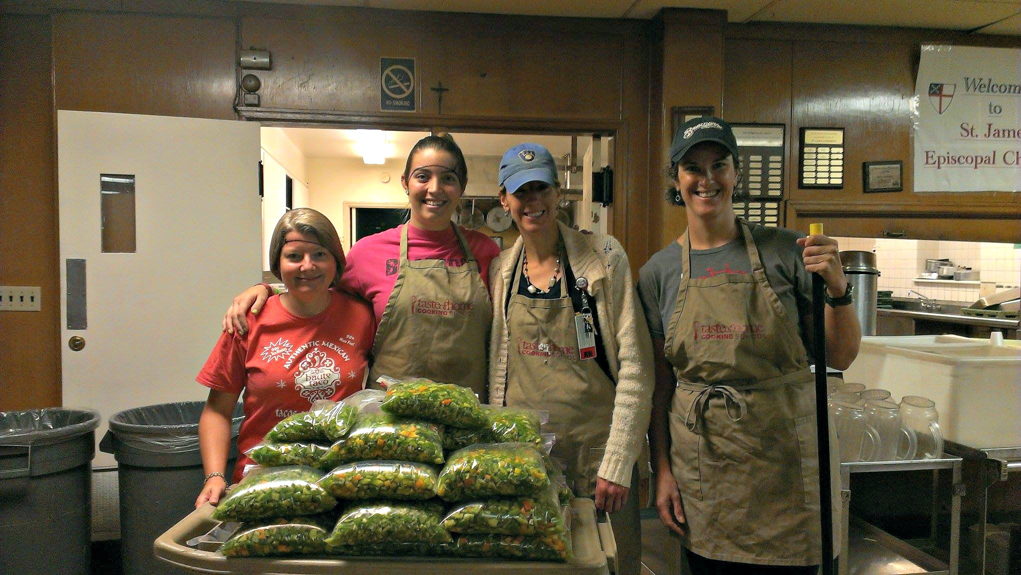 Dora and returning produce project volunteers after a pepper-filled session