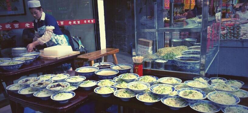 Muslim Quarter: preparing Liang Pi (cold noodles) Mi Pi (rice noodles) Softer and whiter then the Gan Milan Pi. Chili oil, vinegar, Salt, sesame sauce    Below: more street food in the Muslim Quarter, Xian
