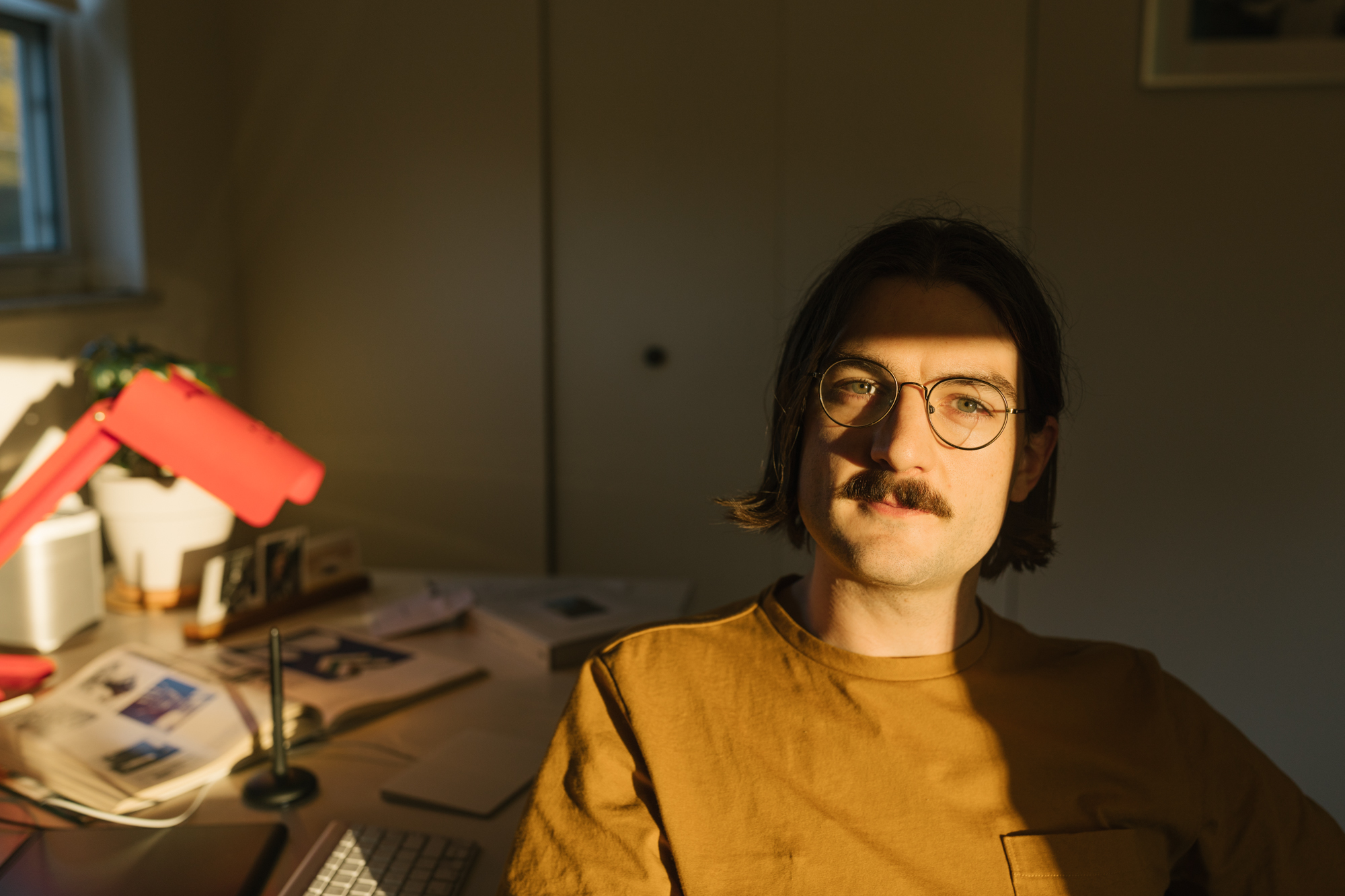 Environmental portrait of Aaron Lowell Denton in his office in Bloomington, Indiana.