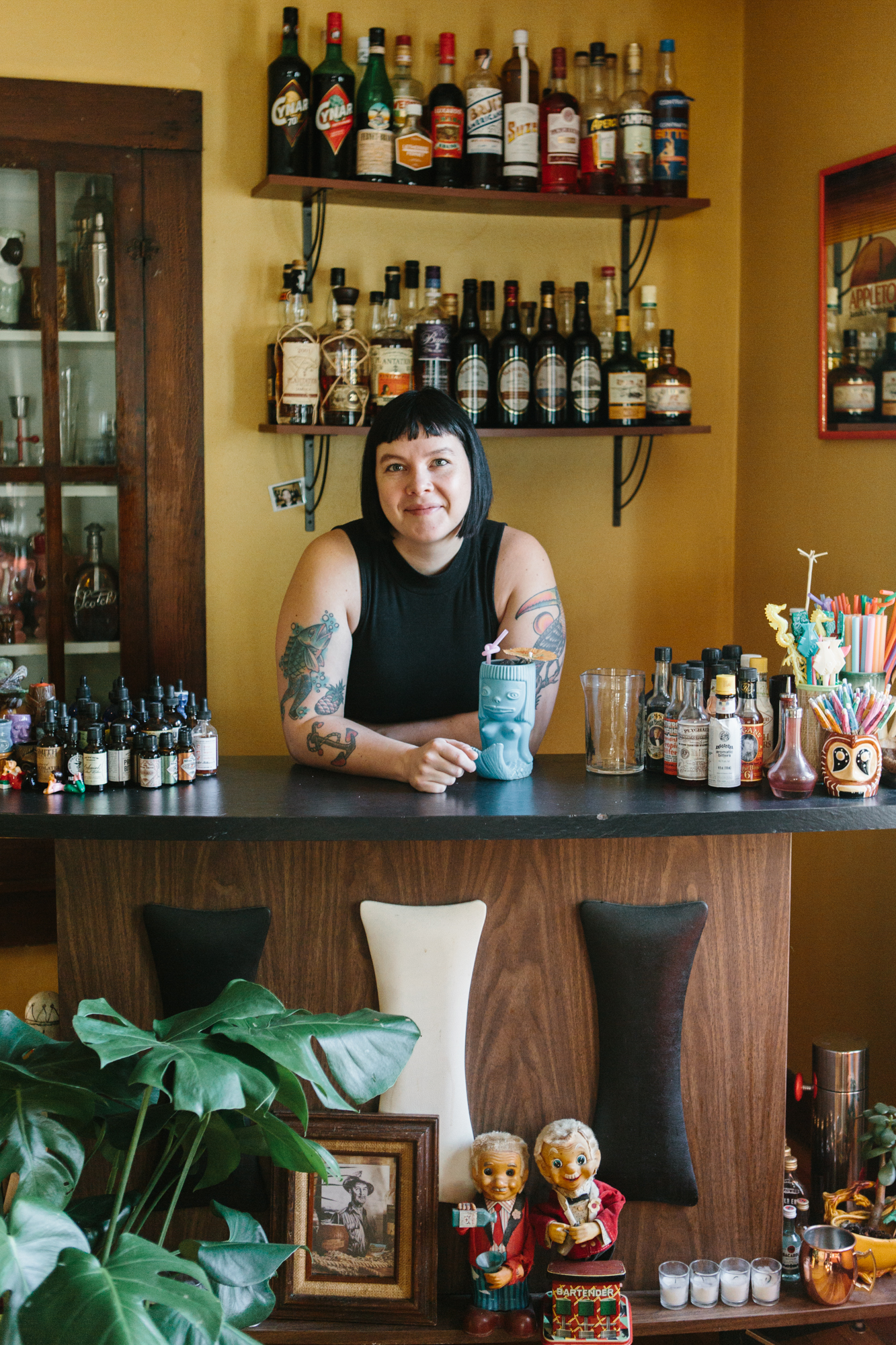 An environmental portrait of a bartender in her home in Bloomington, Indiana.