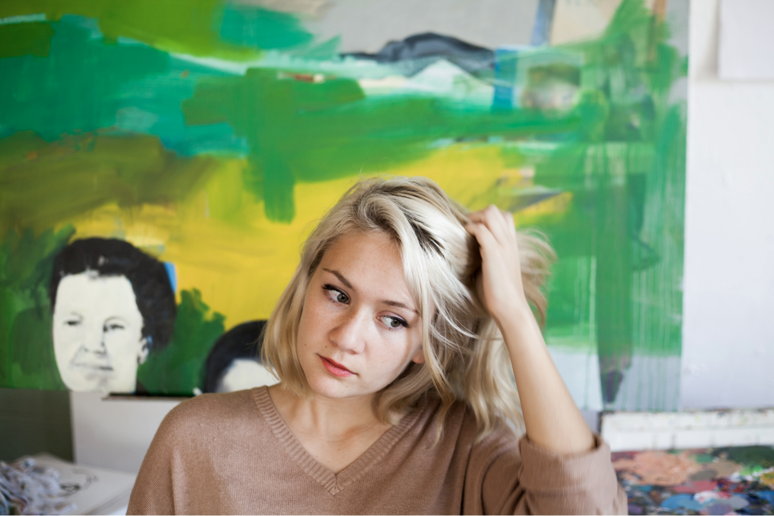 An environmental photo of a woman in her painting studio in Bloomington, Indiana.