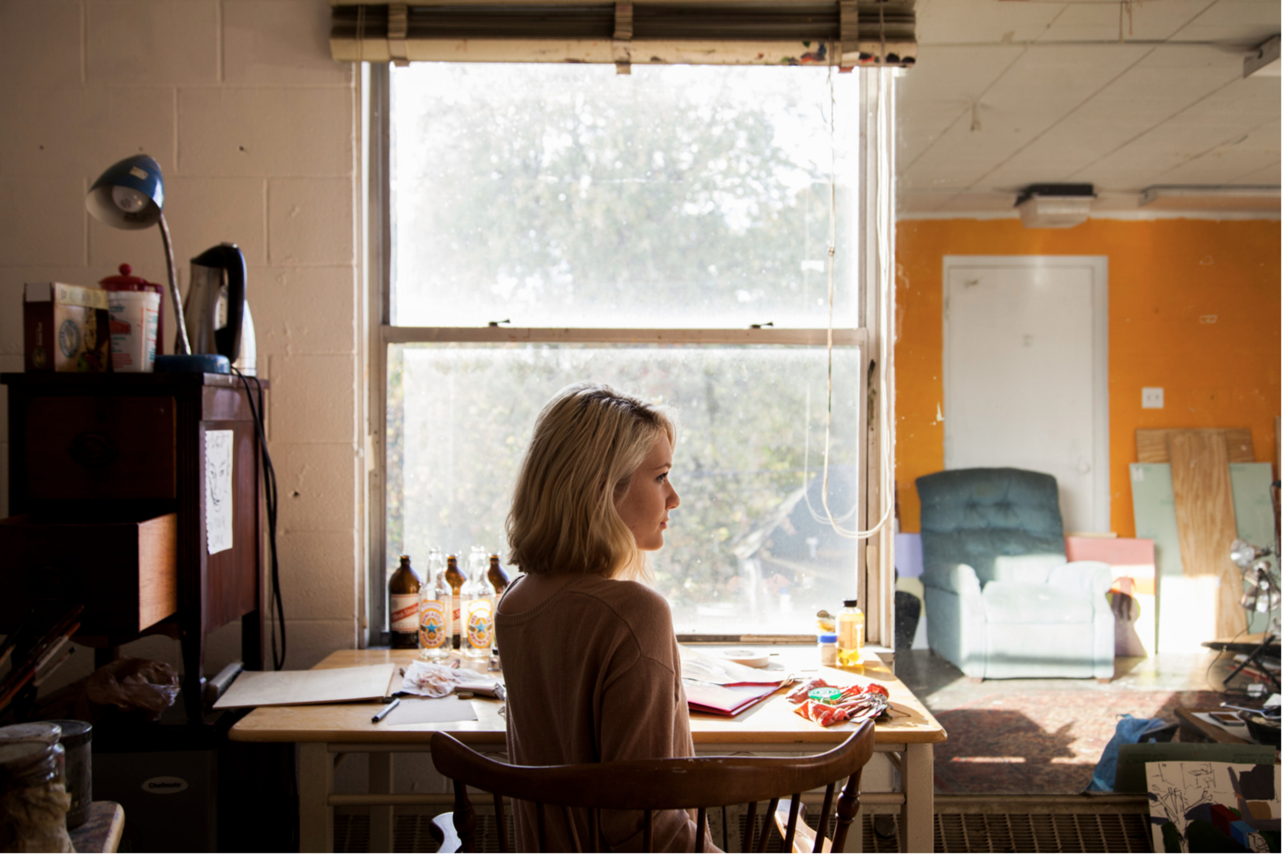 Environmental portrait of a woman in her painting studio in Bloomington, Indiana.