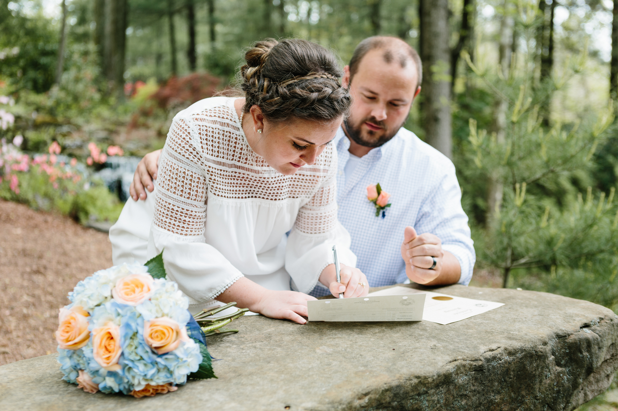 A photograph of a couple getting married at their elopement in Bloomington, Indiana.