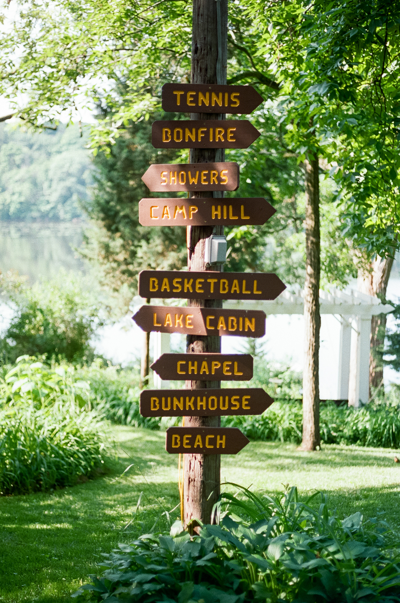 A photo the direction post at  Camp Wandawega  in Elkhorn, Wisconsin during Let's Camp 2018 photographed for  Driftless magazine  and hosted by  The Glossary  and  Feminest .