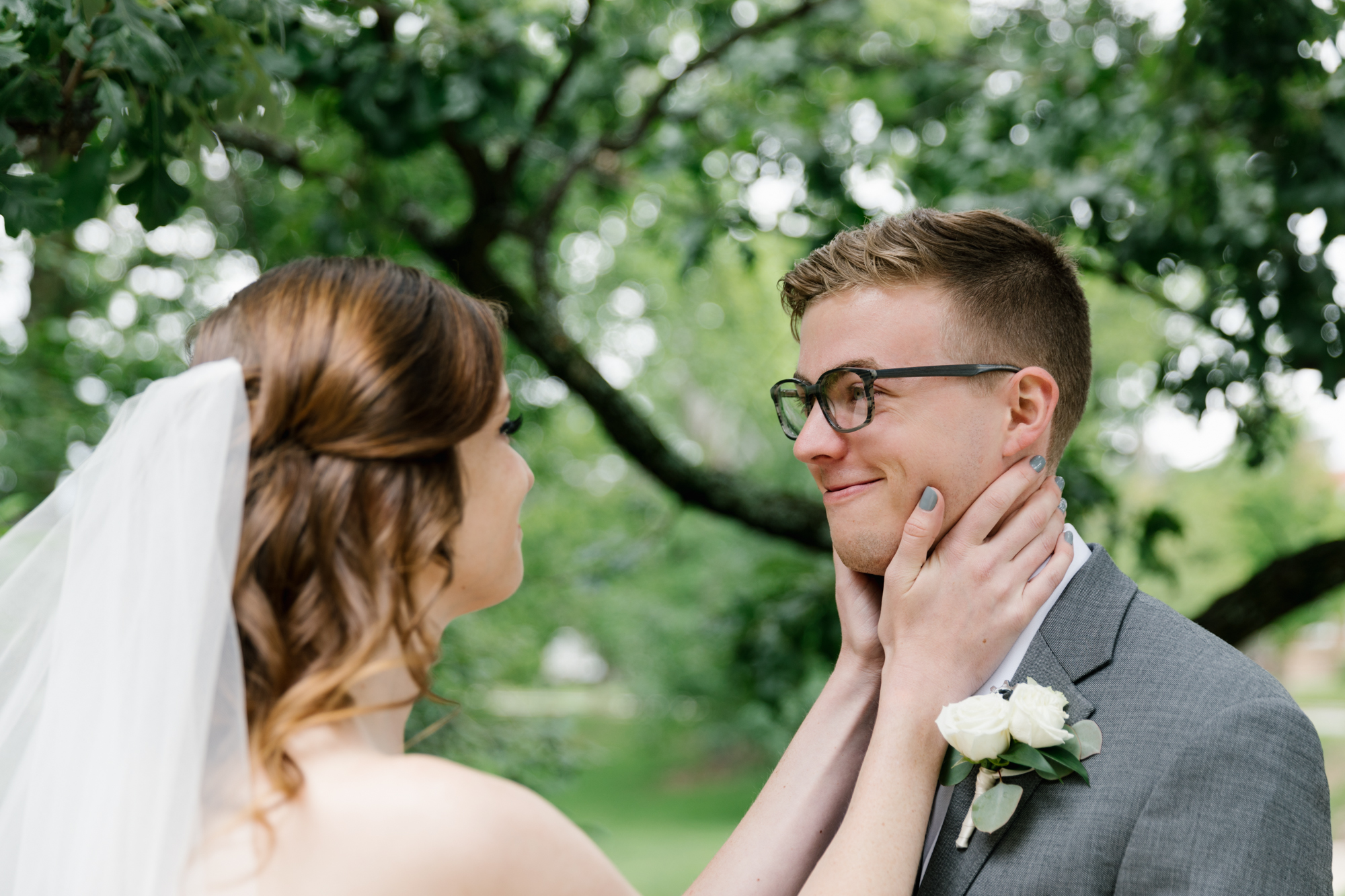 Photography from a couple's first look before their wedding at the Indiana Memorial Union at Indiana University in Bloomington, Indiana.