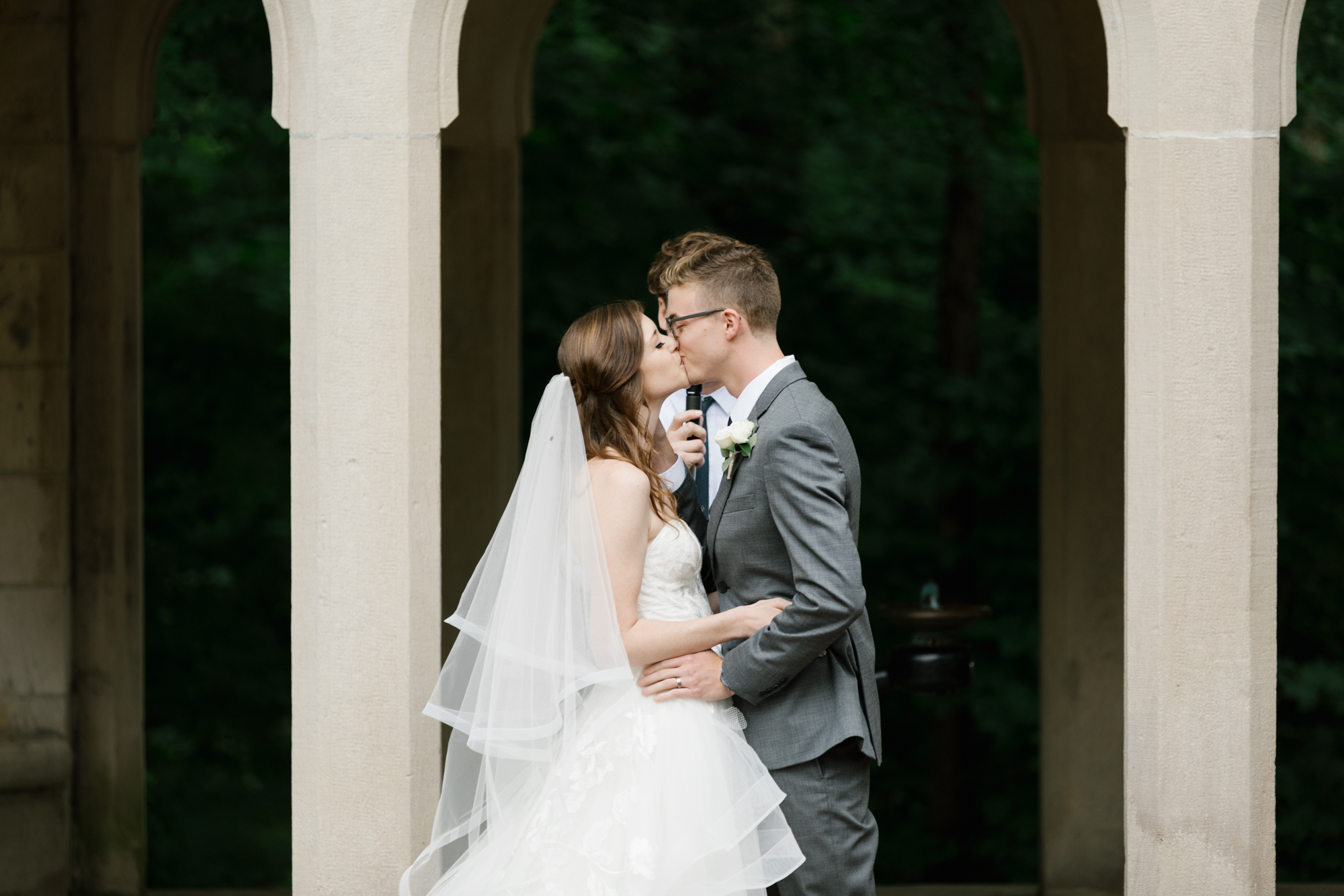 A photo of a couple kissing during their wedding at the Indiana Memorial Union at Indiana University in Bloomington, Indiana.