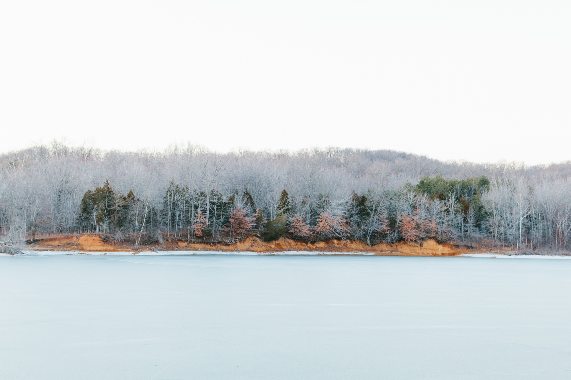 A landscape photography of icy Lake Monroe in Bloomington, Indiana.