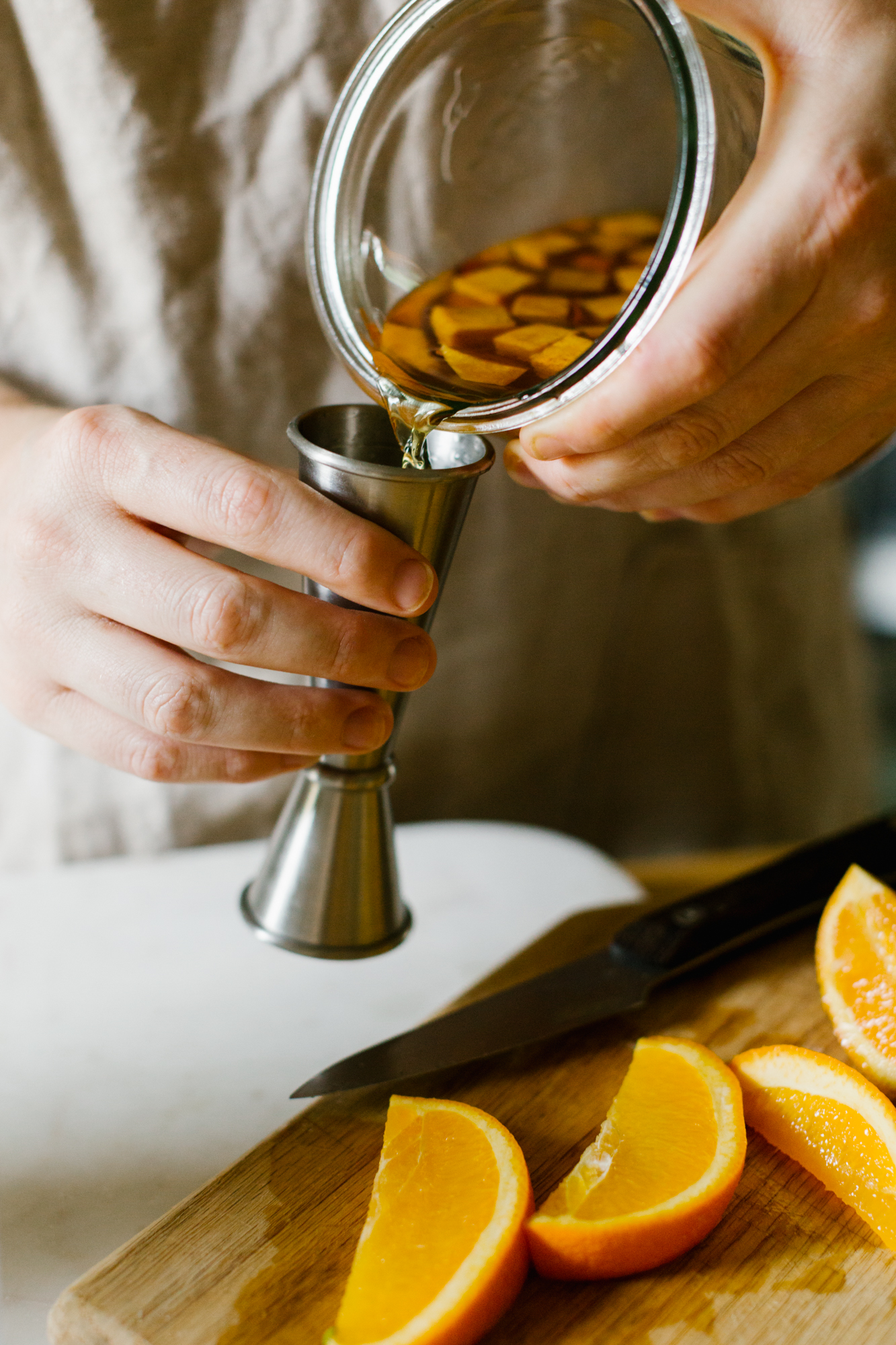 A photo of a woman making a cocktail in Bloomington, Indiana for  Driftless Magazine .