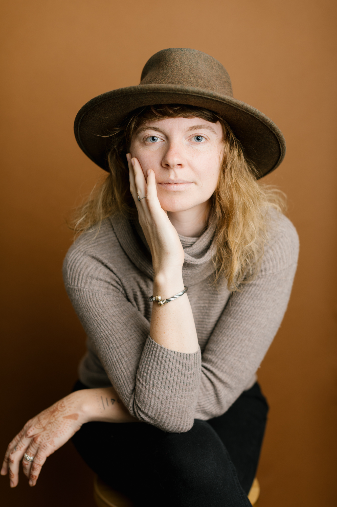 A portrait of a woman in a photography and videography studio in Bloomington, Indiana.