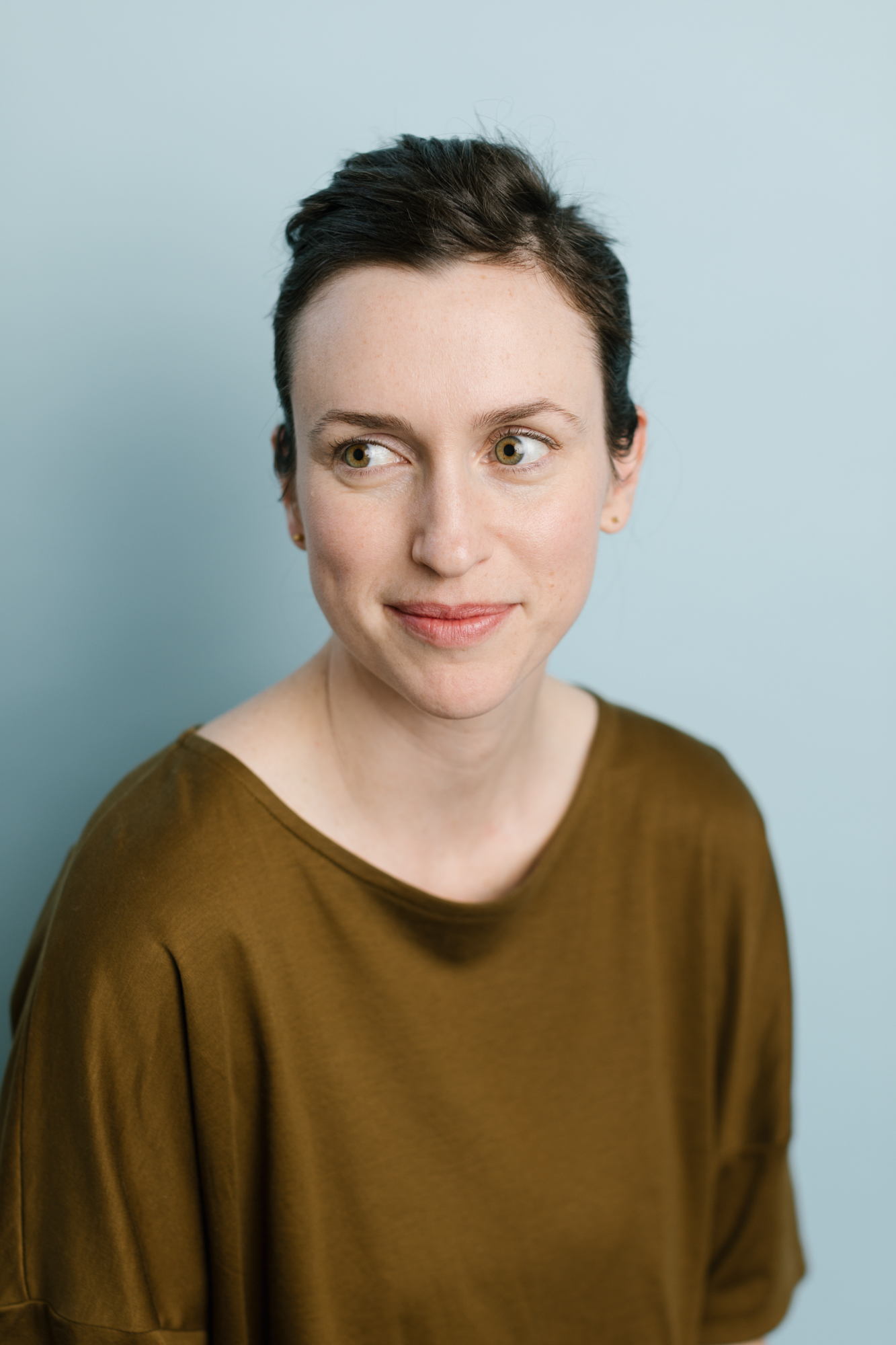 A headshot of a woman in a photography and videography studio in Bloomington, Indiana.
