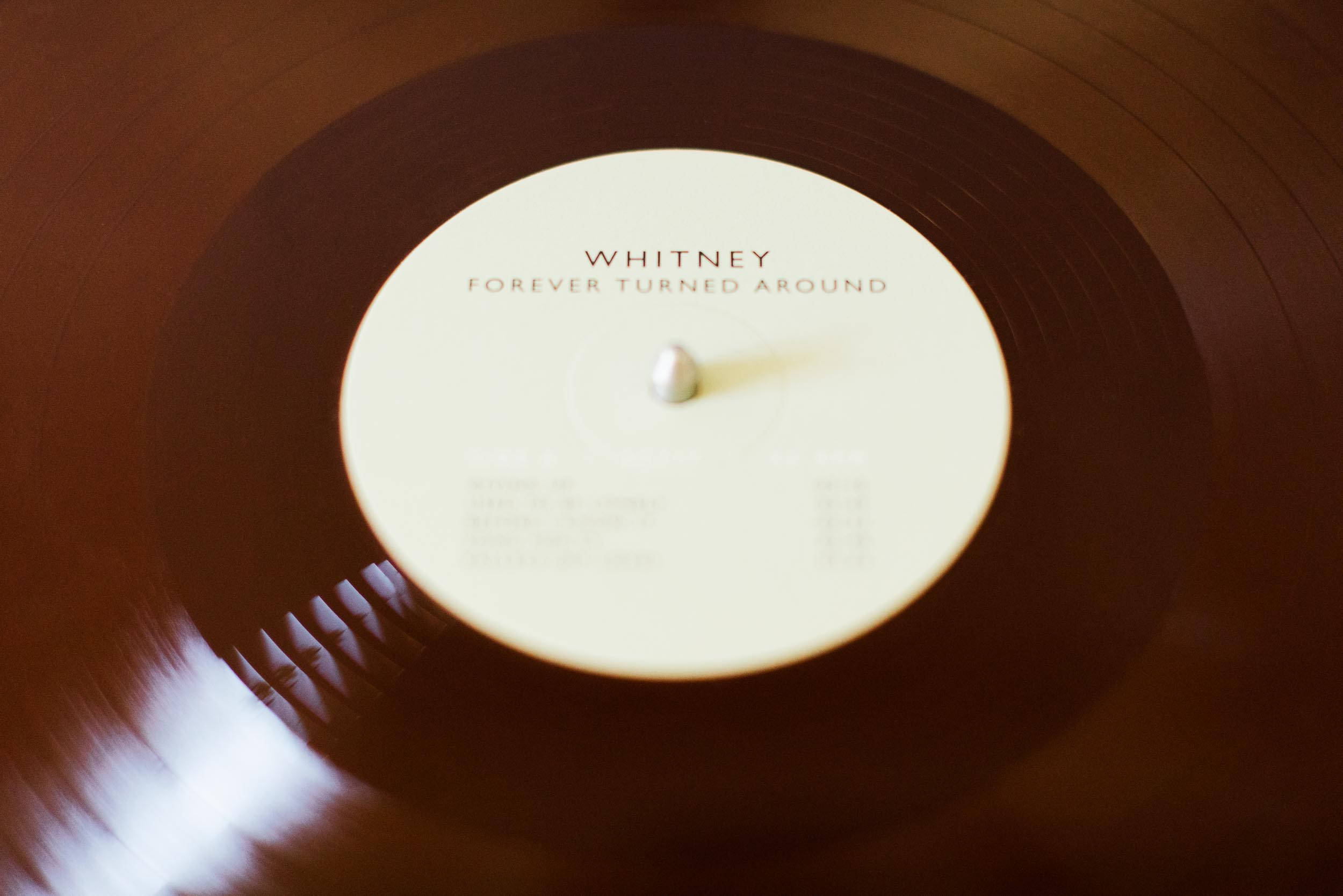 "Music product photography for Whitney's new vinyl record ""Forever Turned Around"" available through Secretly Canadian photographed by Anna Powell Teeter in Bloomington, Indiana."