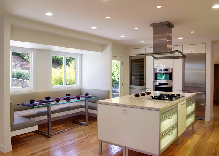 A custom banquette completes this well appointed kitchen.