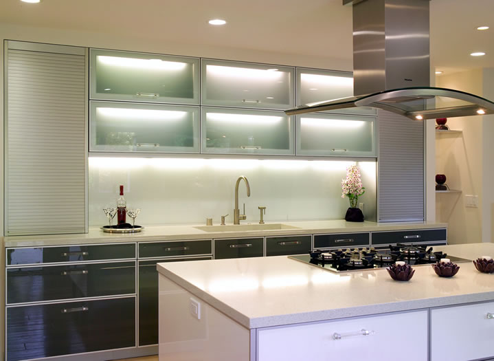 The one piece glass backsplash continues the clean look of the Caesarstone counters.